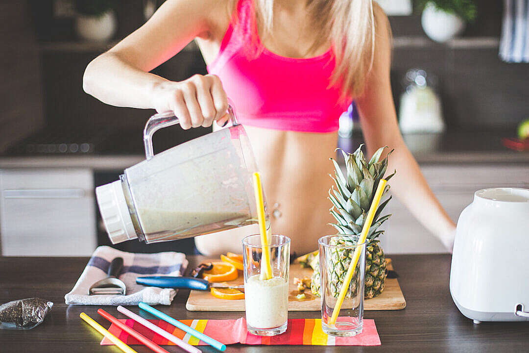Download Fitness Girl Preparing Healthy Smoothie FREE Stock Photo