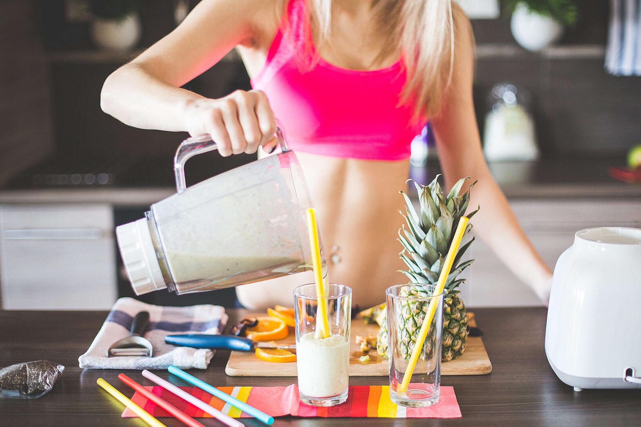 Fitness Girl Preparing Healthy Smoothie Free Stock Photo