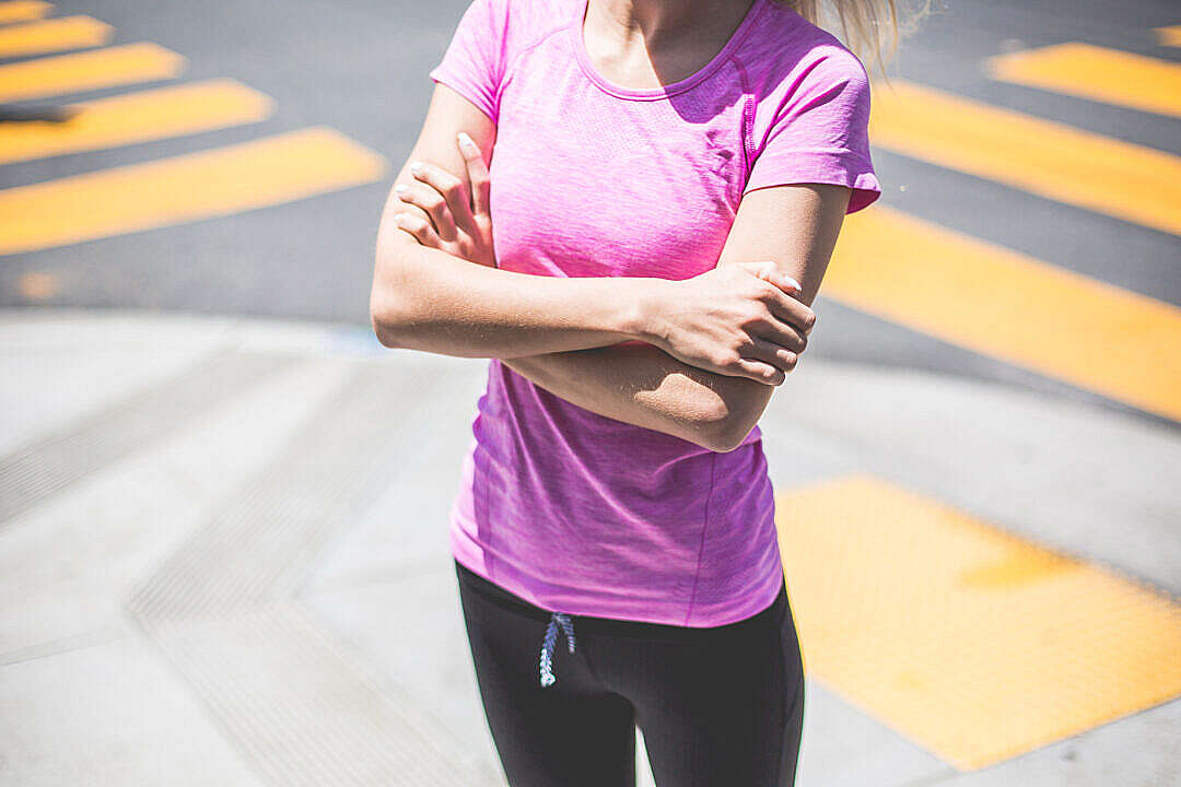 Download Fitness Girl Waiting At a Street Corner Near The Pedestrian Crossing FREE Stock Photo