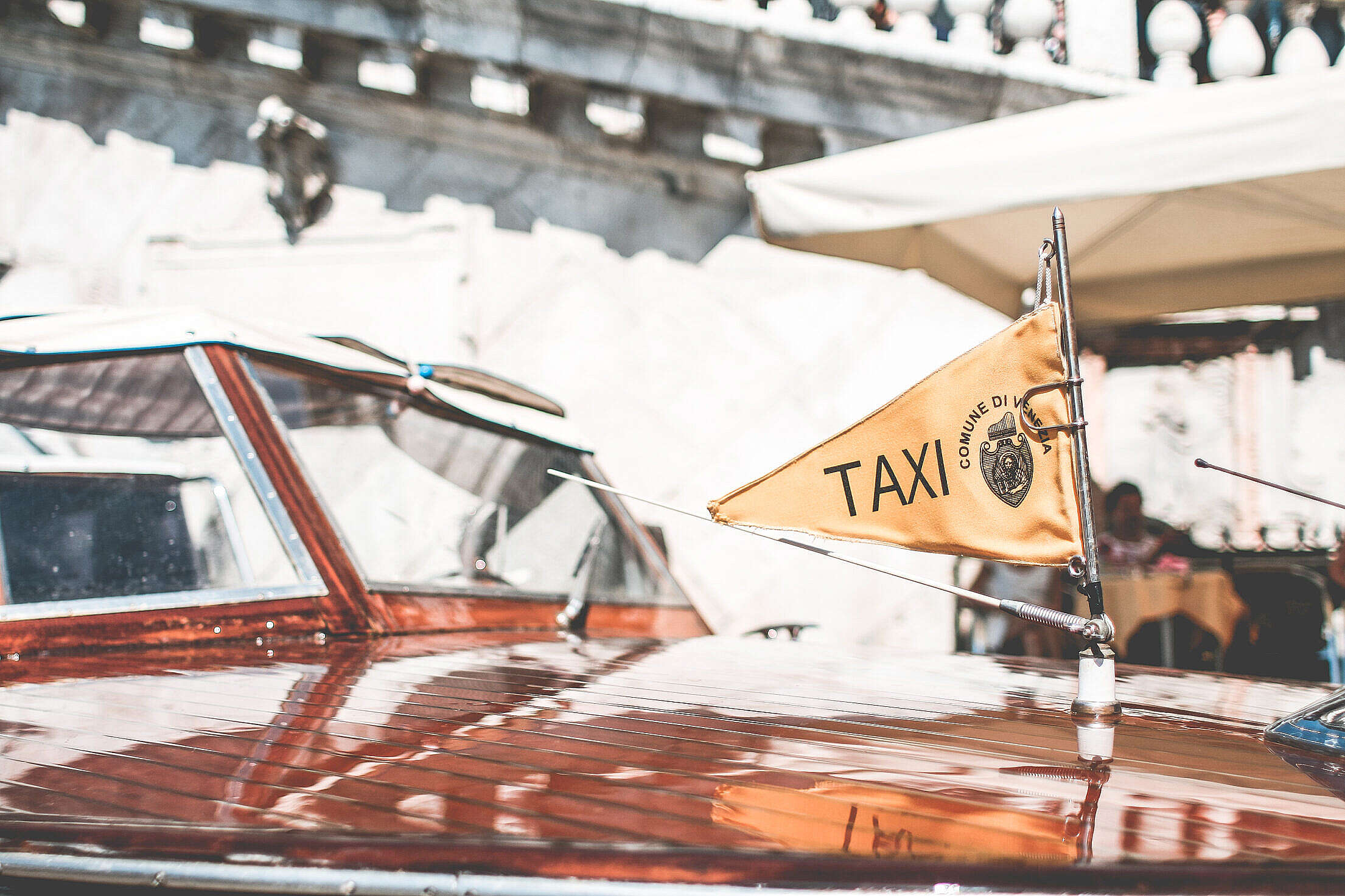 Flag on Iconic Boat Taxi in Venice, Italy Free Stock Photo