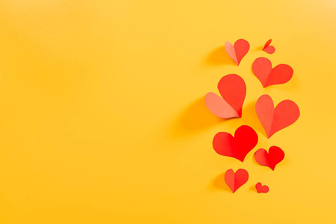 Download Flying Hearts on Yellow Background FREE Stock Photo