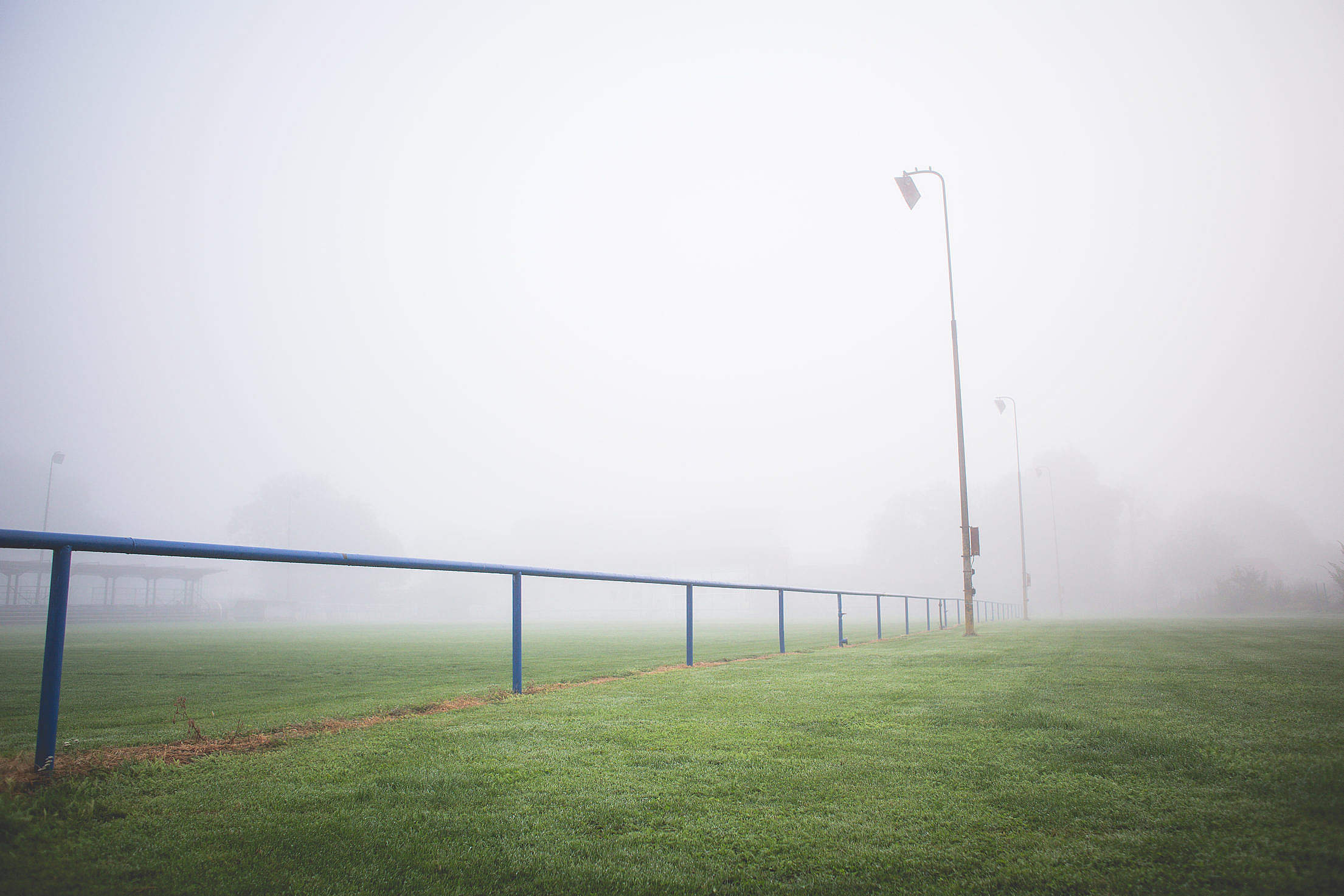 Foggy Football Pitch in the Morning Free Stock Photo