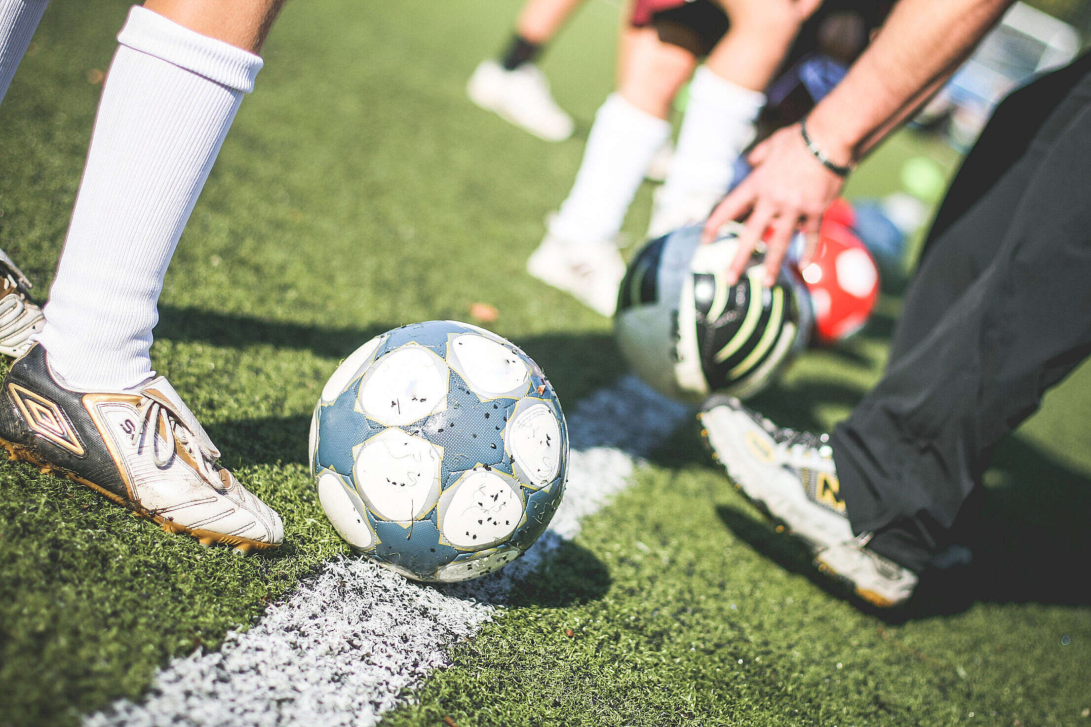 Football Field Training Players with Soccer Ball Free Stock Photo