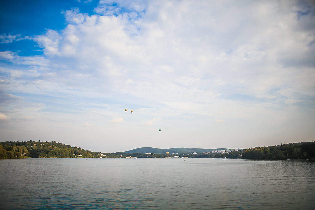 Download Four Hot Air Balloons over Lake FREE Stock Photo