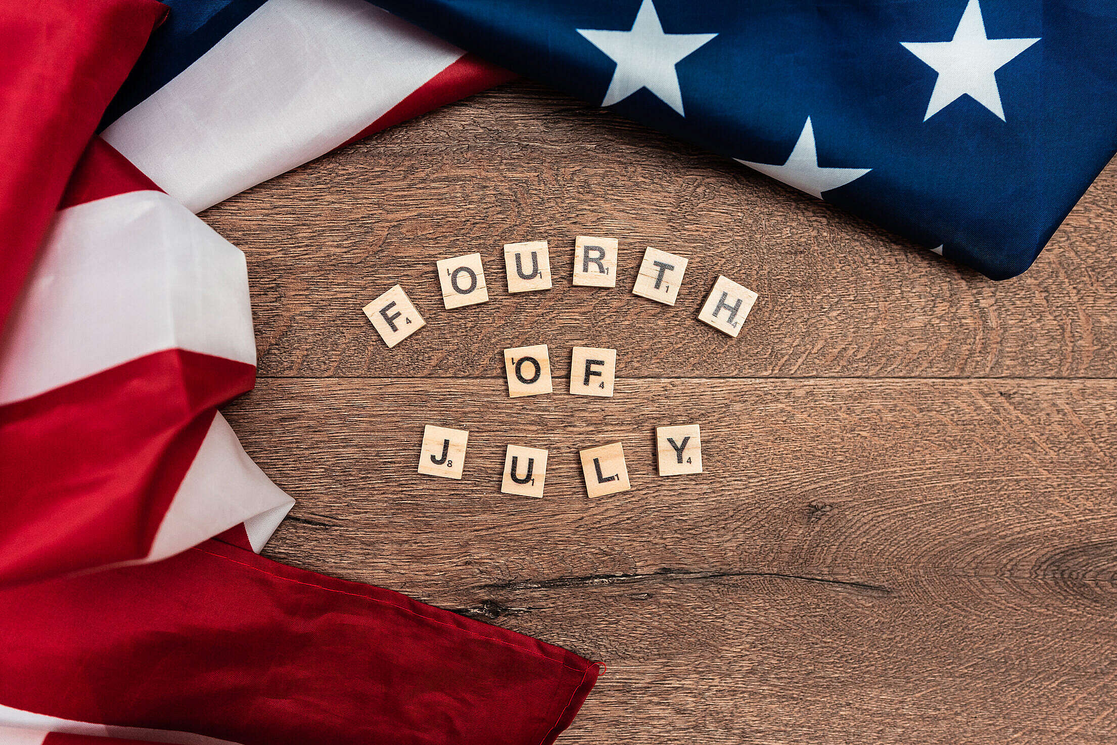 Fourth of July Lettering with American Flag Free Stock Photo