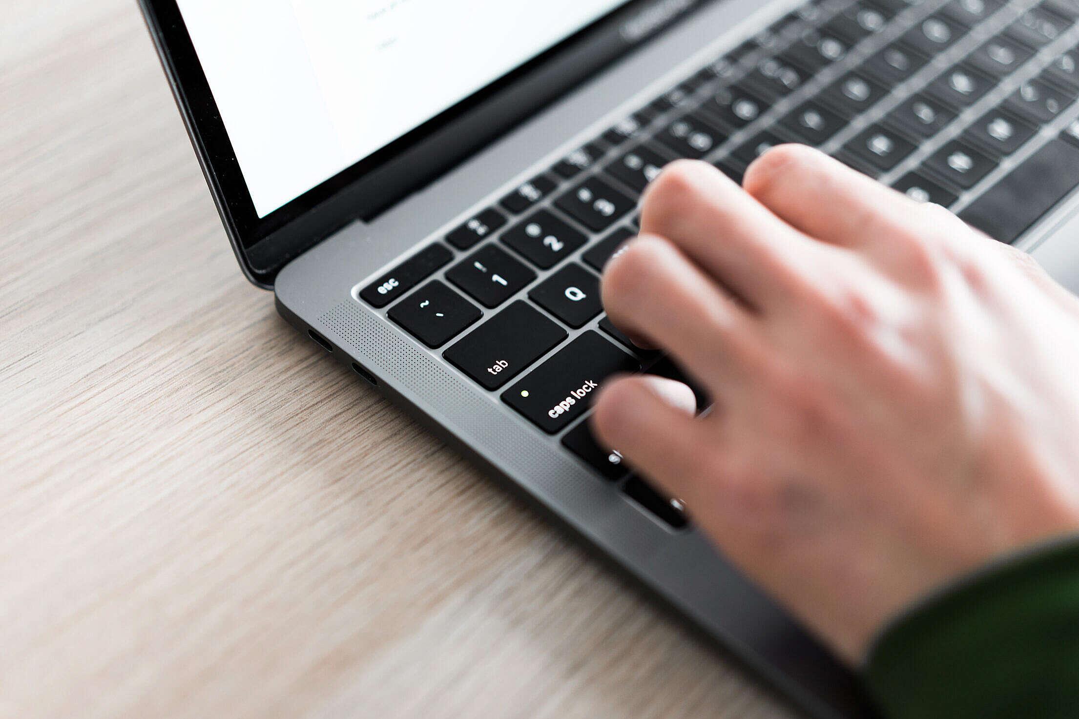 Freelance Man Typing on His Laptop Close Up Free Stock Photo