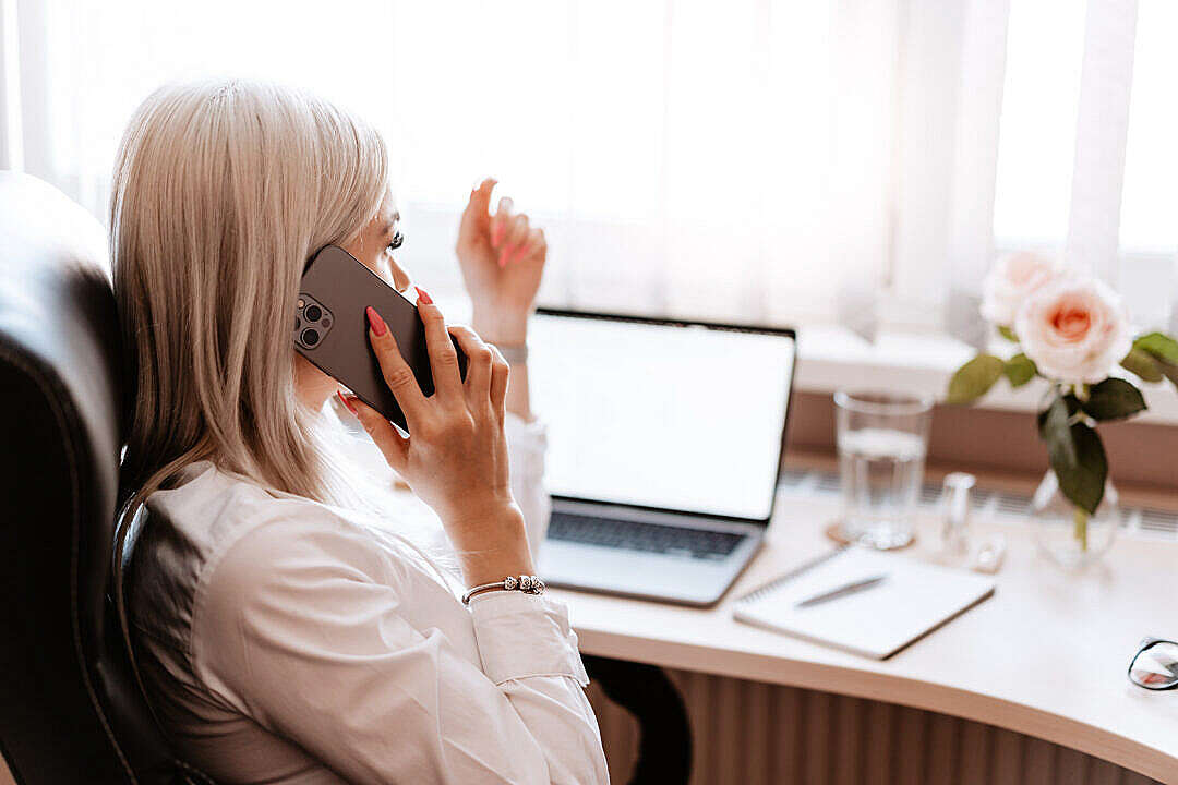 Download Freelance Woman Entrepreneur Calling in Home Office FREE Stock Photo