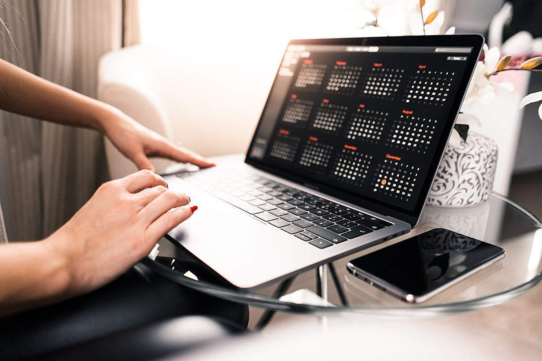 Download Freelance Woman Working on Her MacBook FREE Stock Photo