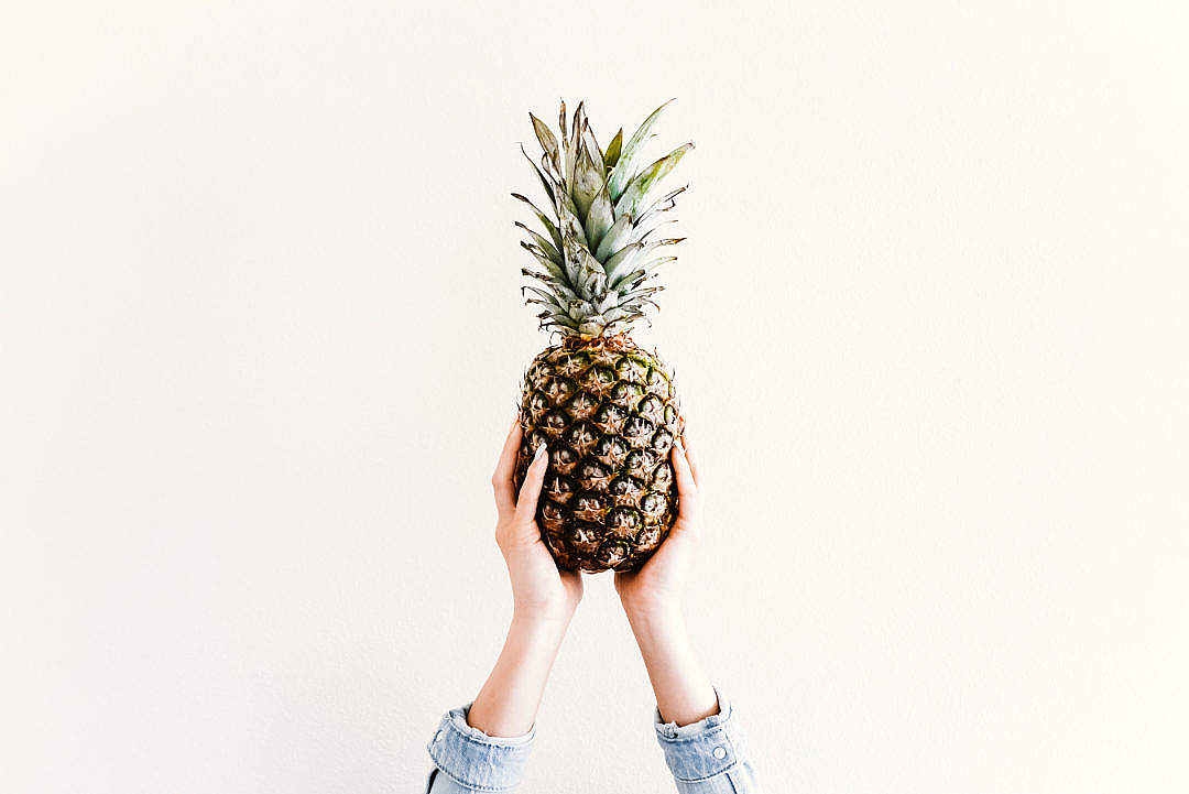 Download Fresh Ananas/Pineapple in Female Hands FREE Stock Photo