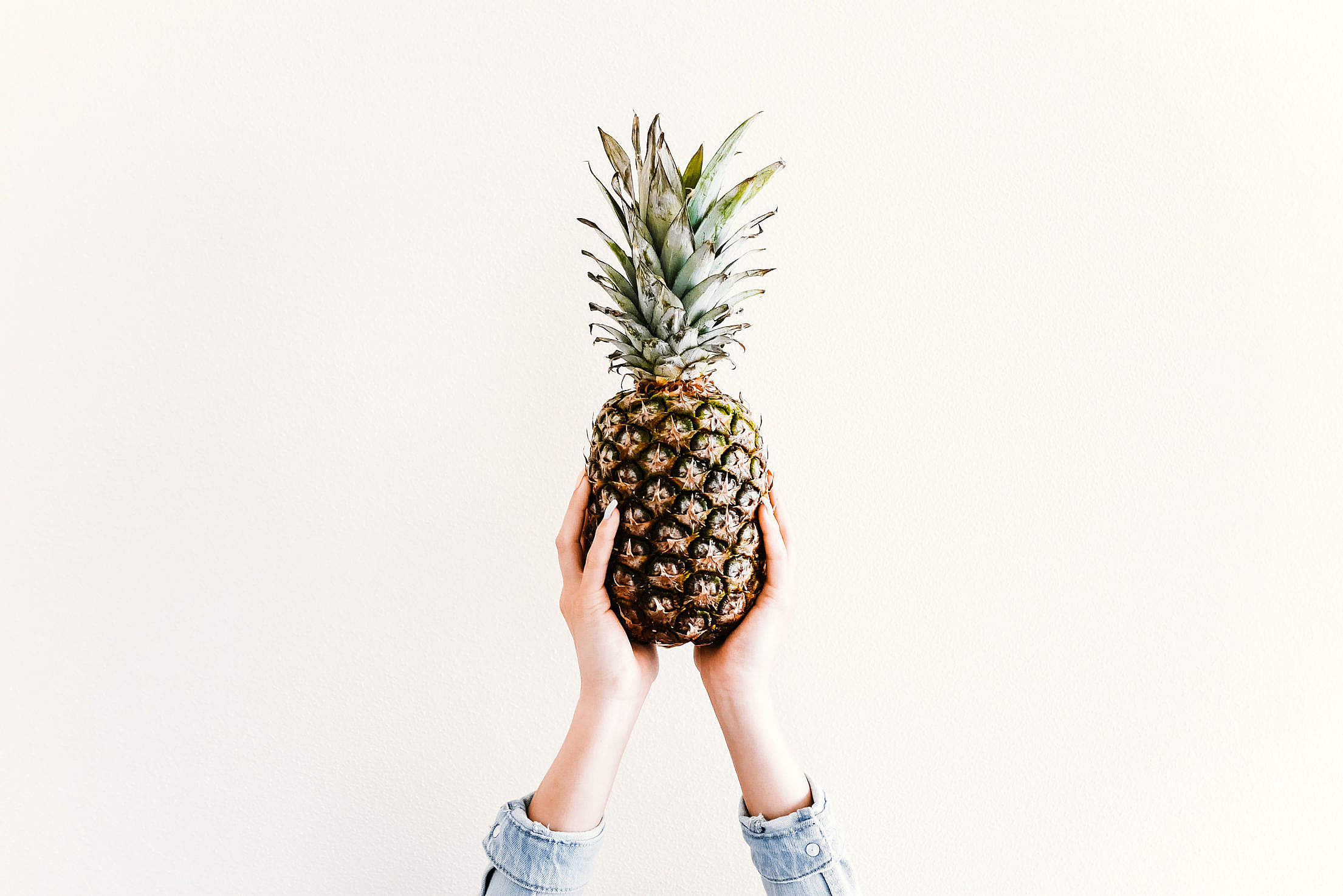 Fresh Ananas/Pineapple in Female Hands Free Stock Photo