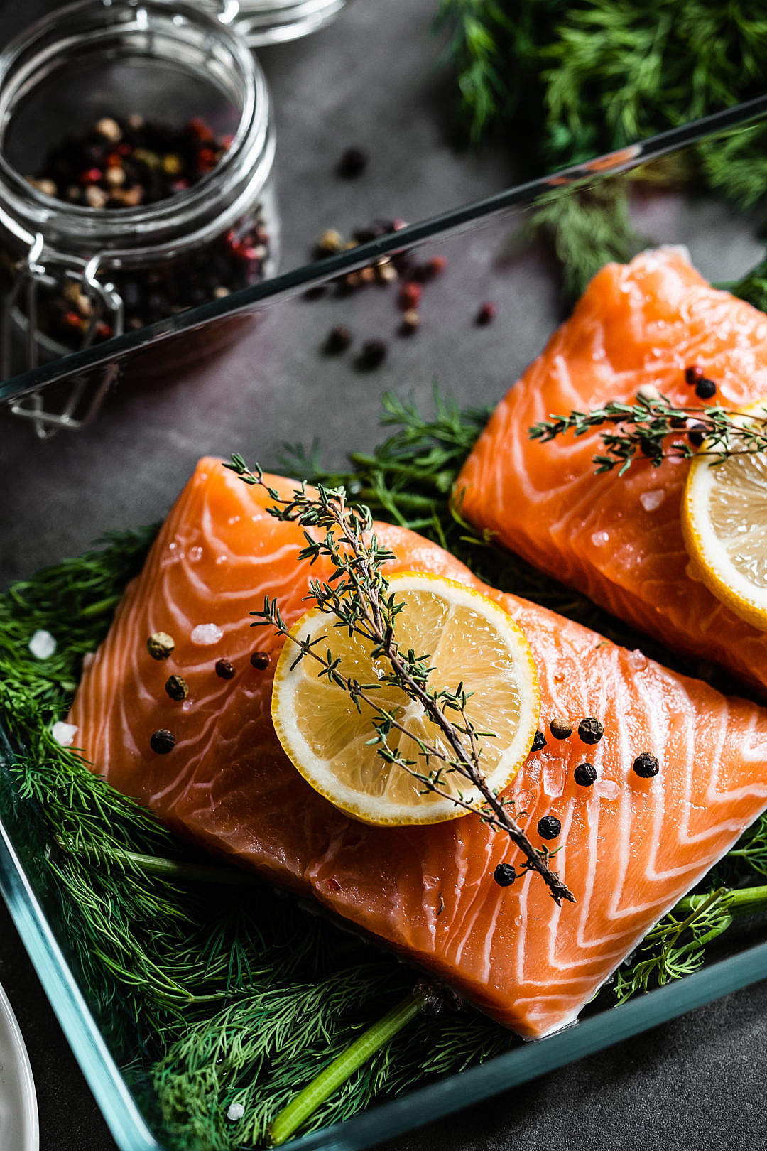Download Fresh Raw Salmon Fillets with Aromatic Herbs FREE Stock Photo