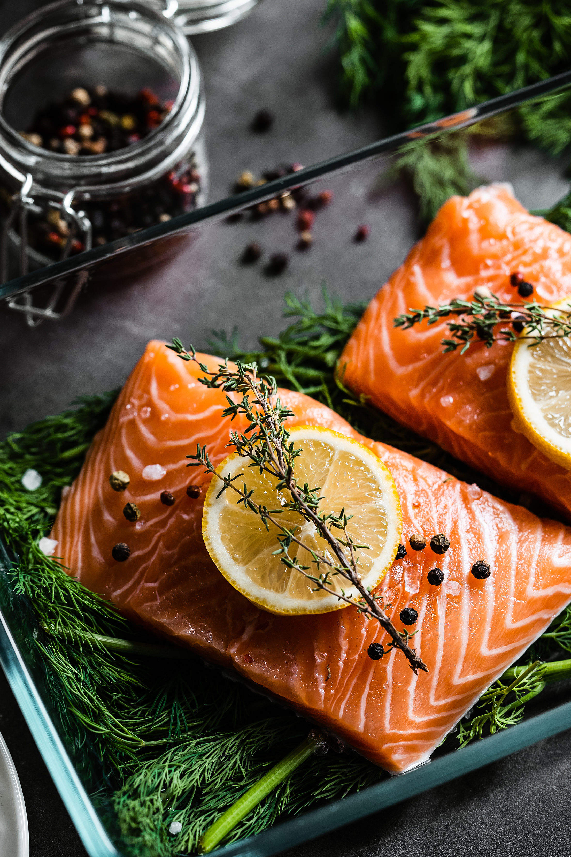 Fresh Raw Salmon Fillets with Aromatic Herbs Free Stock Photo