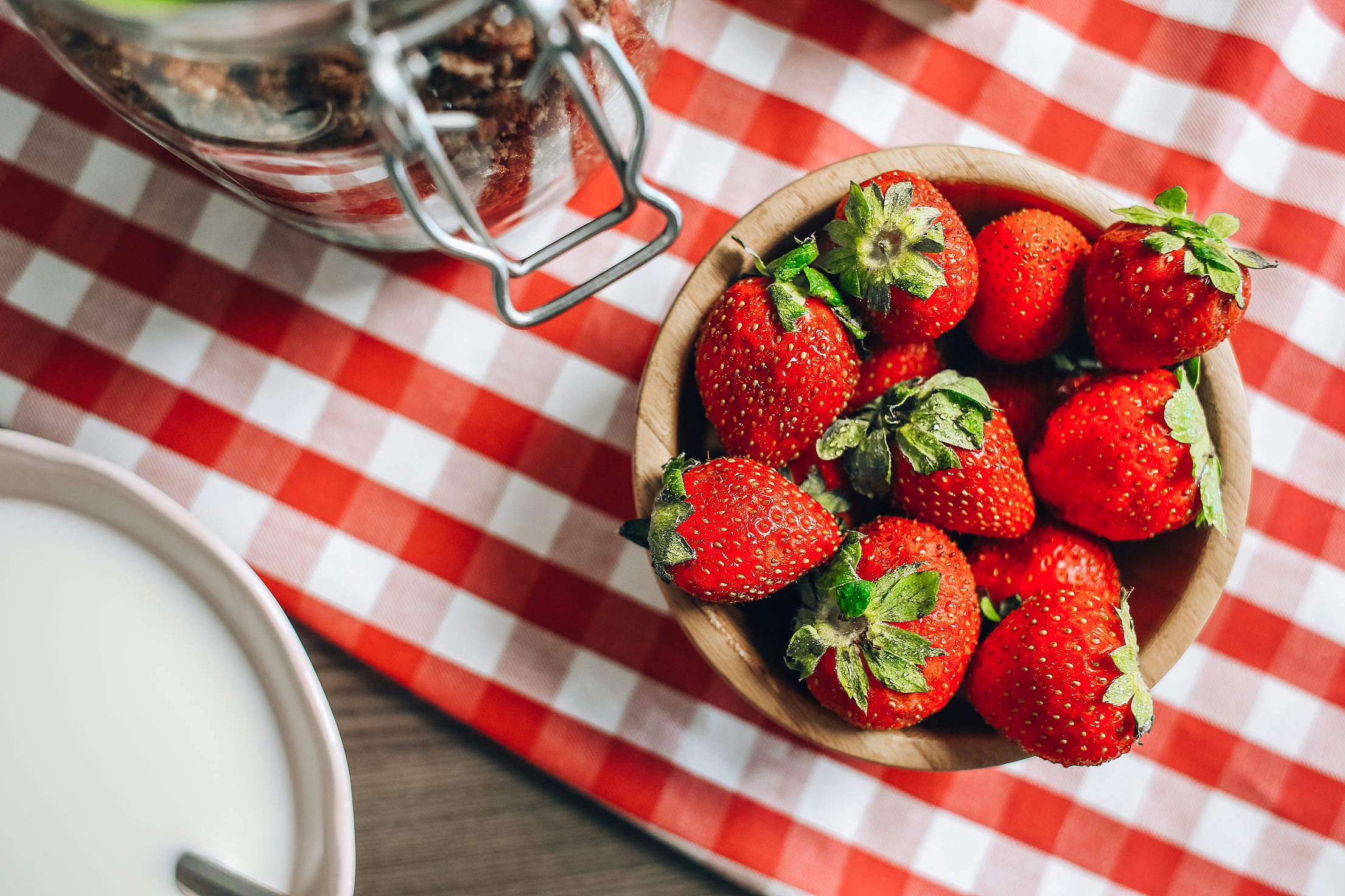 Fresh Strawberries in a Wooden Bowl Free Stock Photo