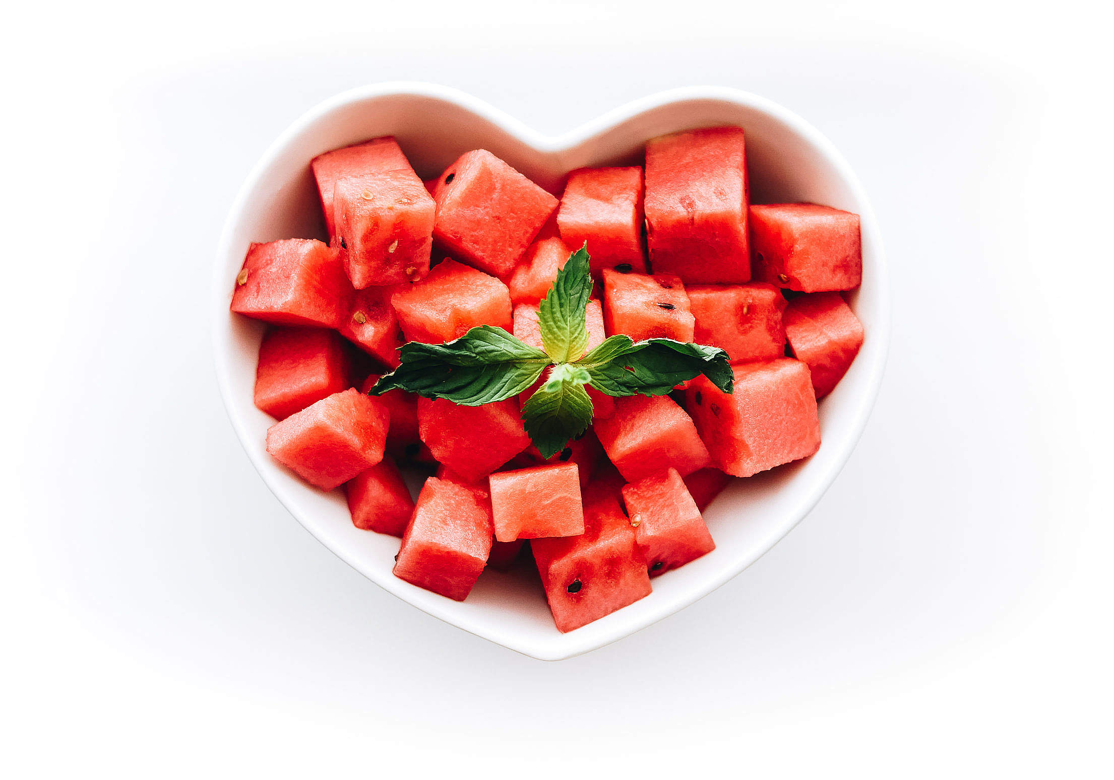 Fresh Watermelon in Heart-Shaped Bowl Free Stock Photo