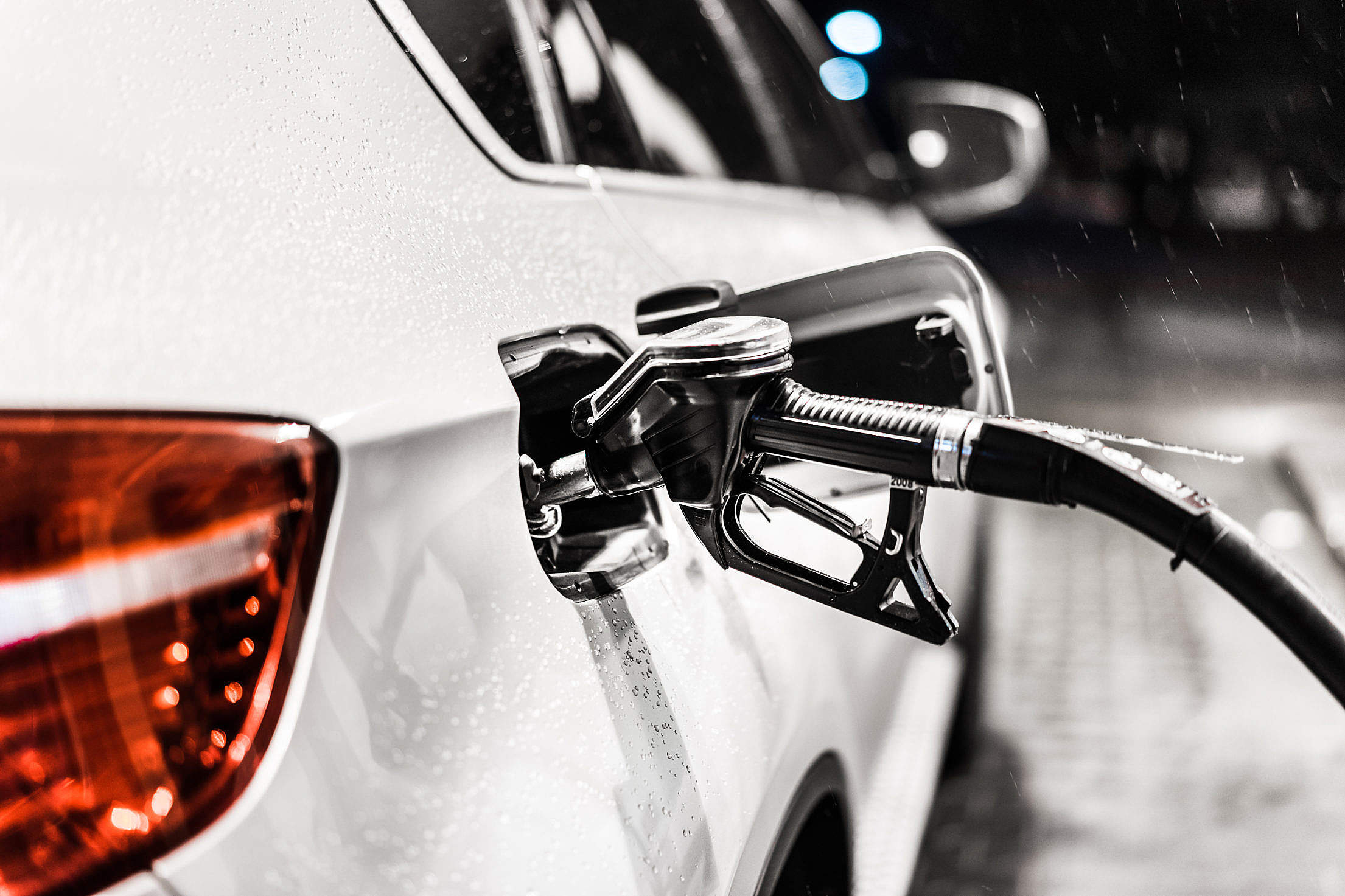 Fueling Up a Car at a Petrol Station Free Stock Photo