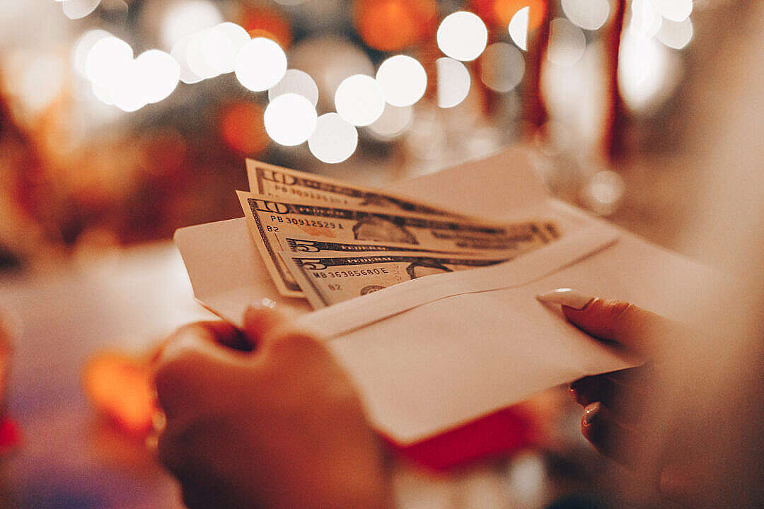 Download Getting Money as a Christmas Gift FREE Stock Photo