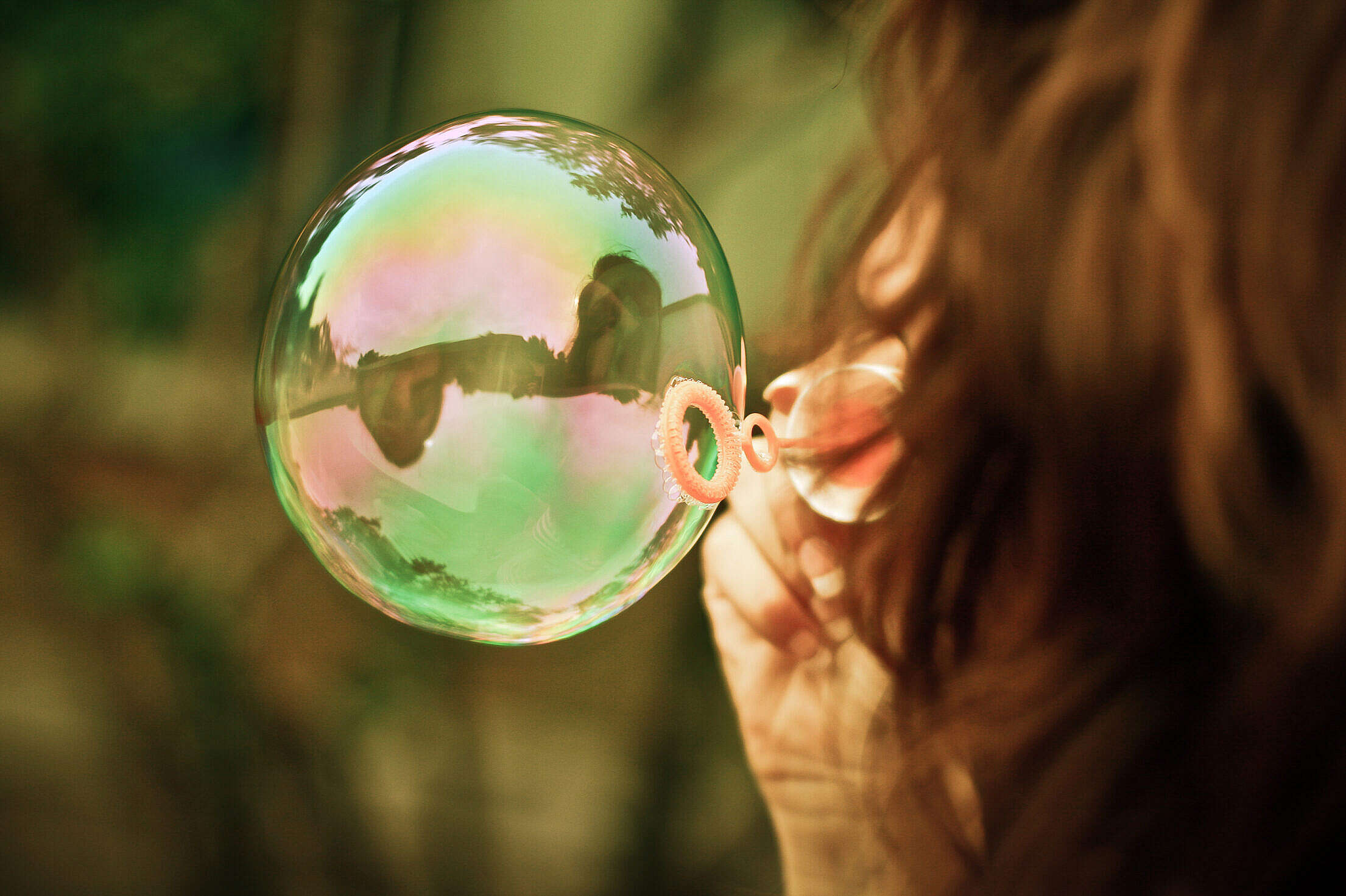 Girl Blowing a Bubble Free Stock Photo