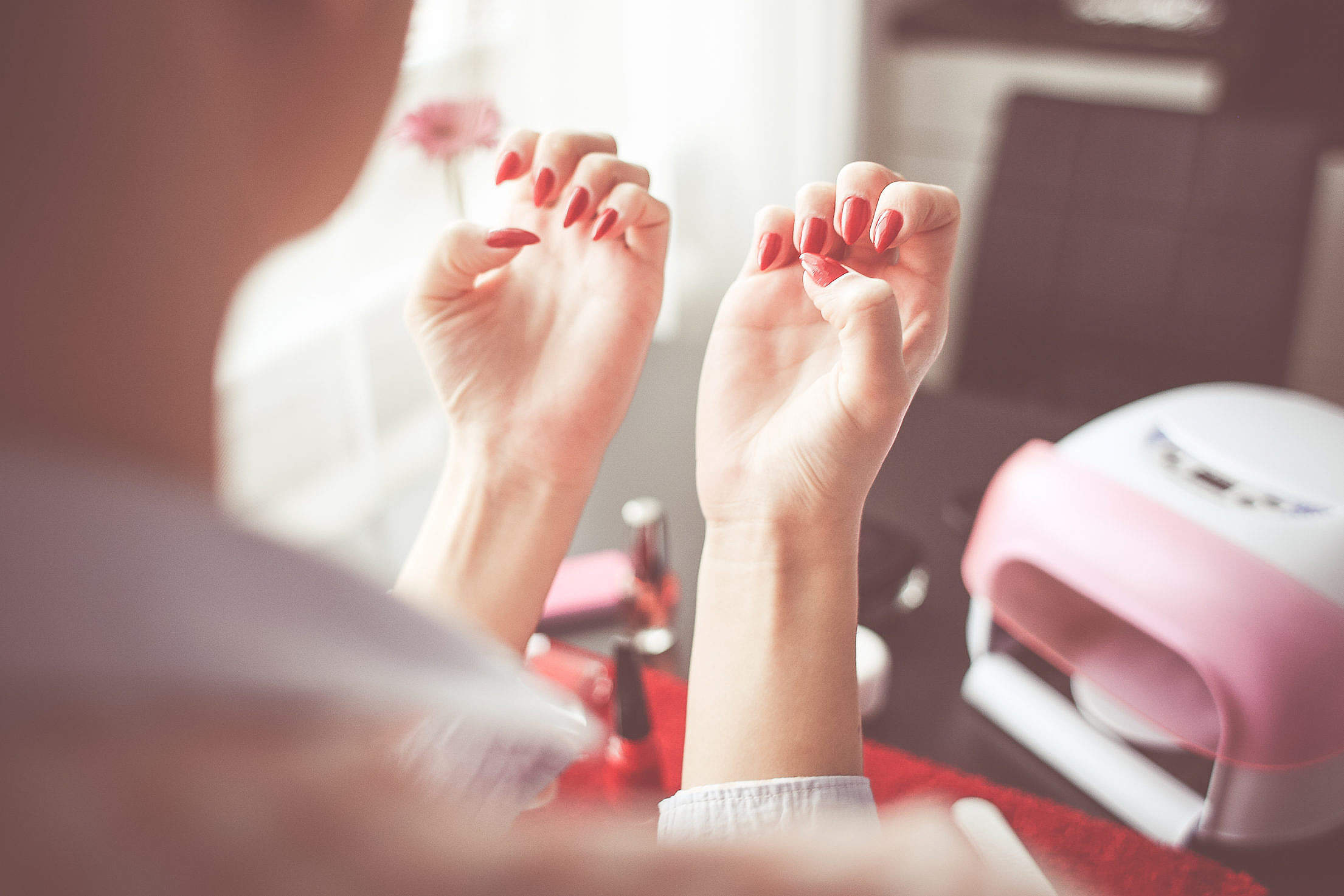 Girl Checking her New Nails Free Stock Photo