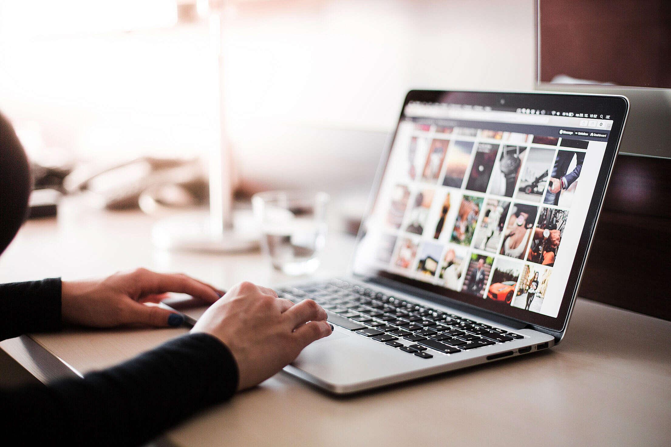 Girl Checking Tumblr on Her MacBook Pro Free Stock Photo