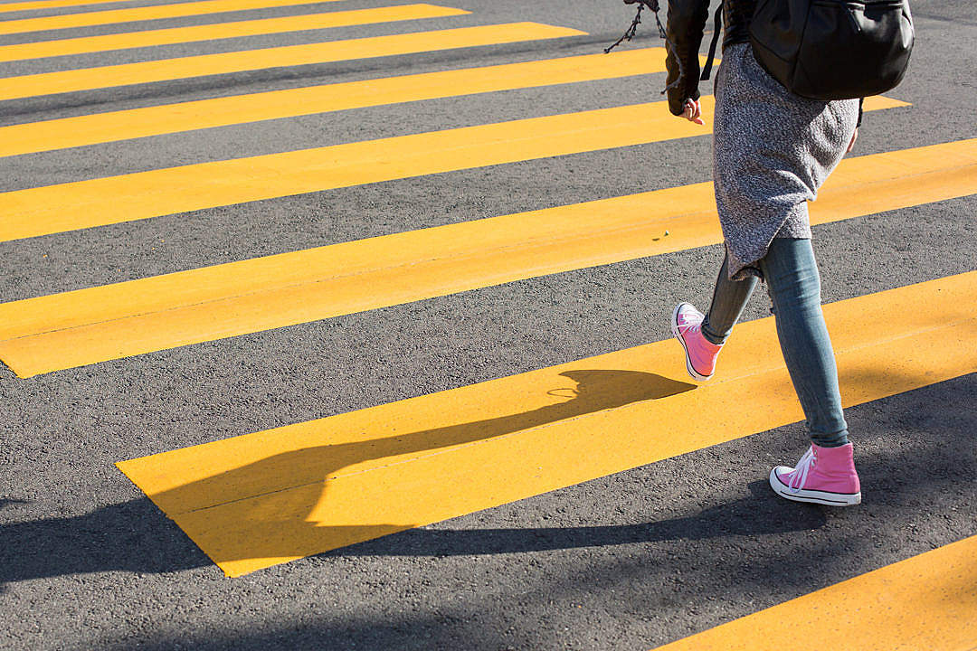 Download Girl Crossing Street on a Yellow Crosswalk FREE Stock Photo