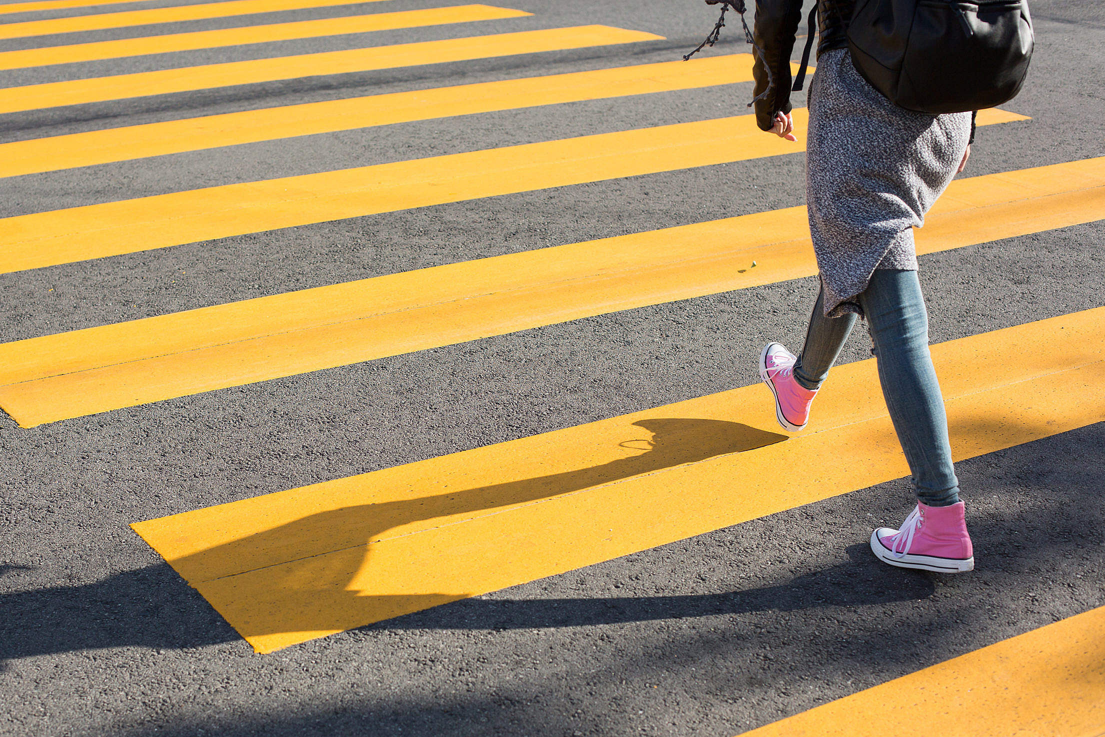 Girl Crossing Street on a Yellow Crosswalk Free Stock Photo