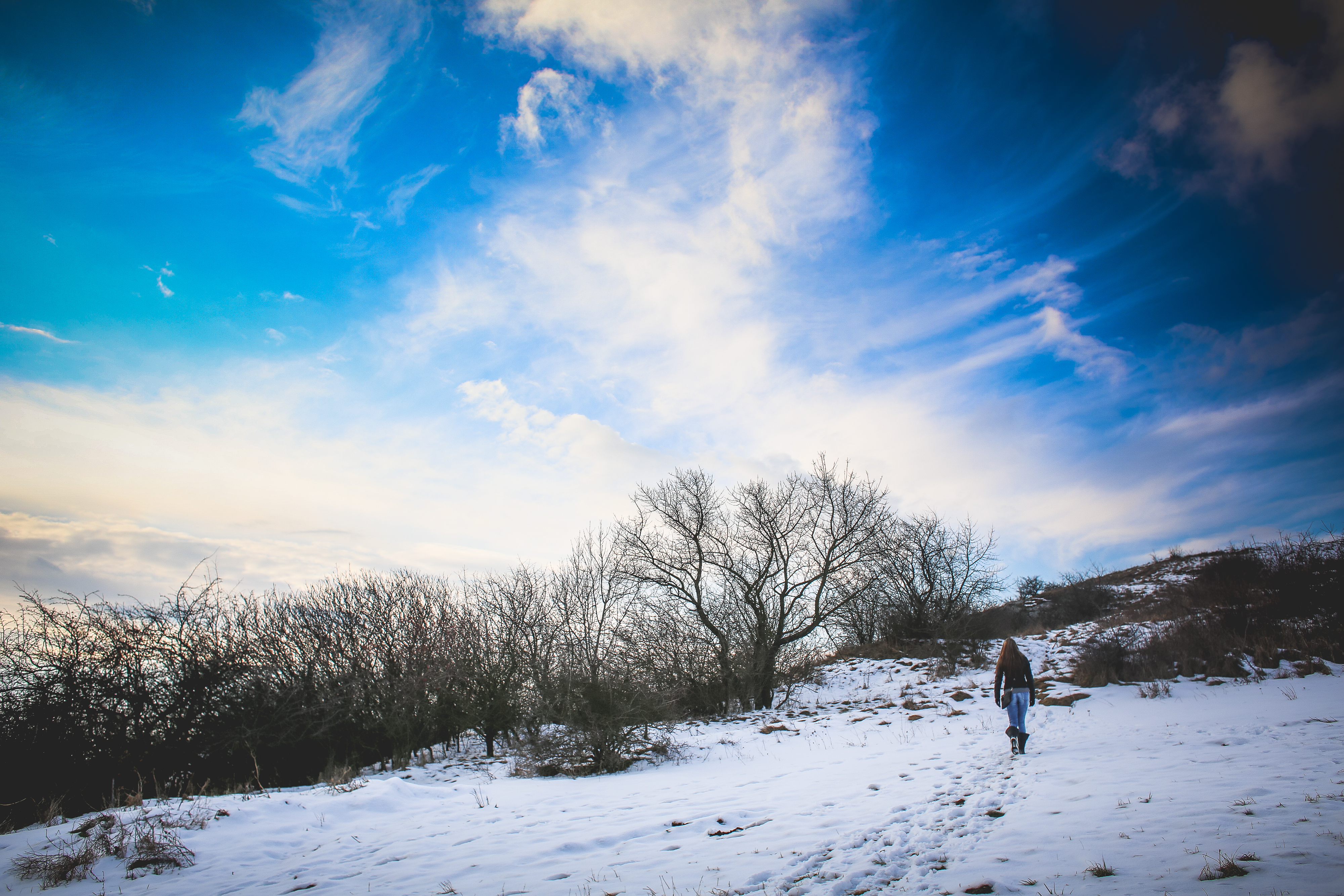Girl Hiking on Snowy Hill Free Stock Photo