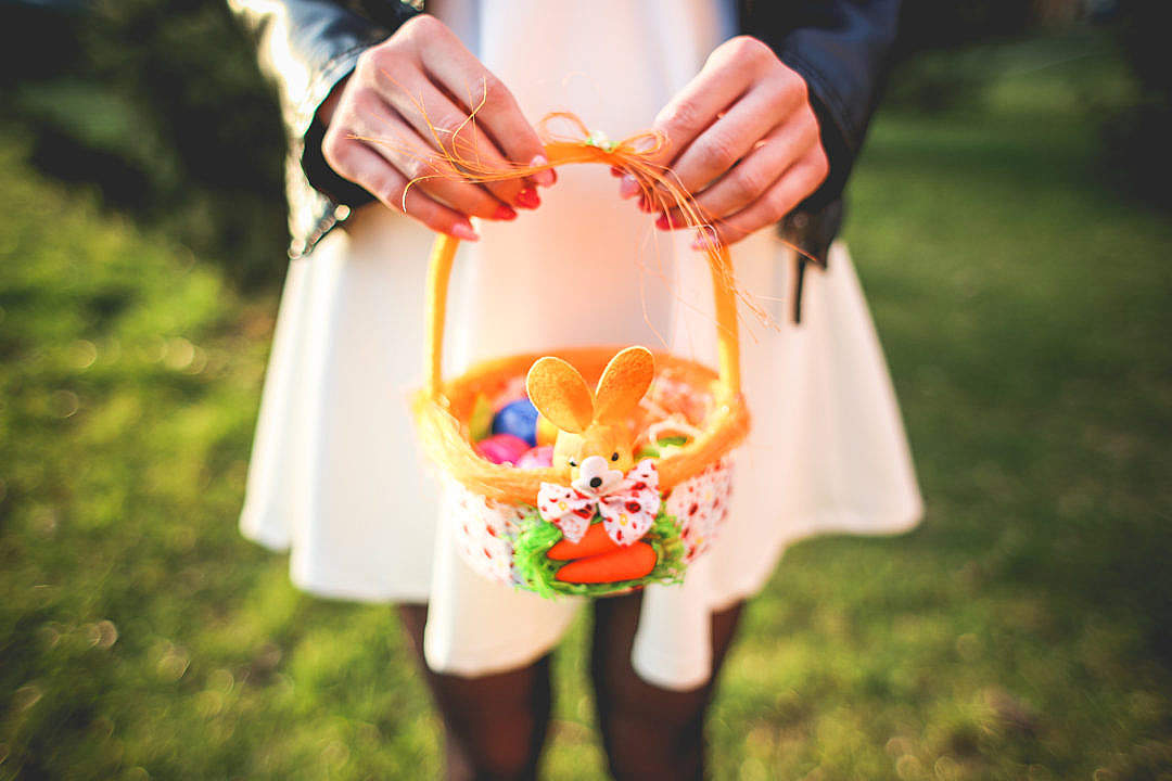 Download Girl Holding Basket with Colored Easter Eggs FREE Stock Photo