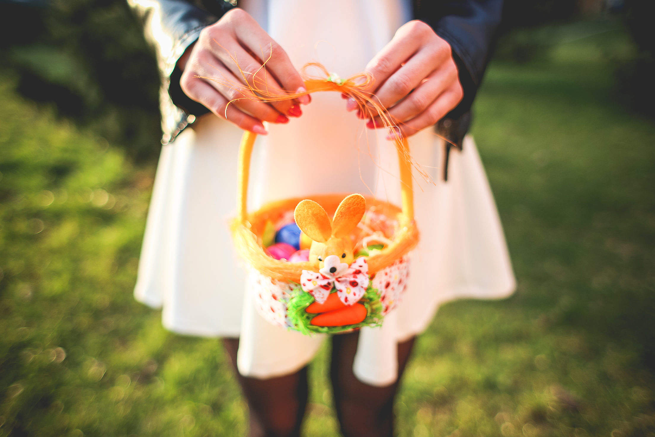 Girl Holding Basket with Colored Easter Eggs Free Stock Photo