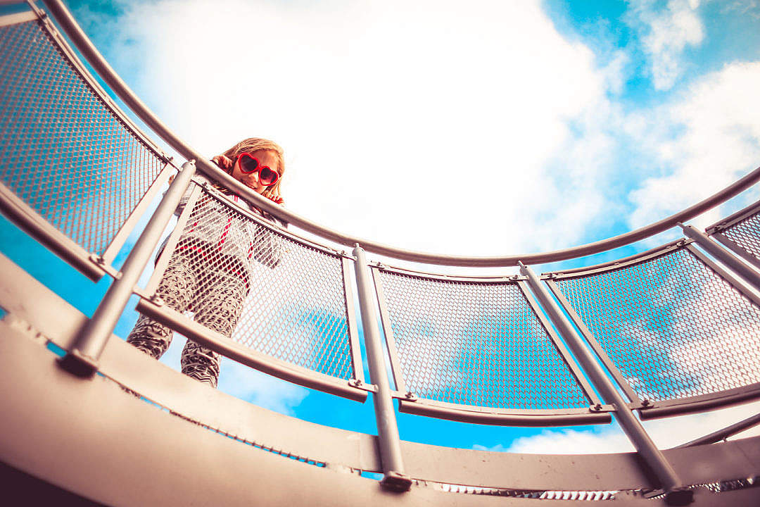 Download Girl Holding Onto The Railing FREE Stock Photo
