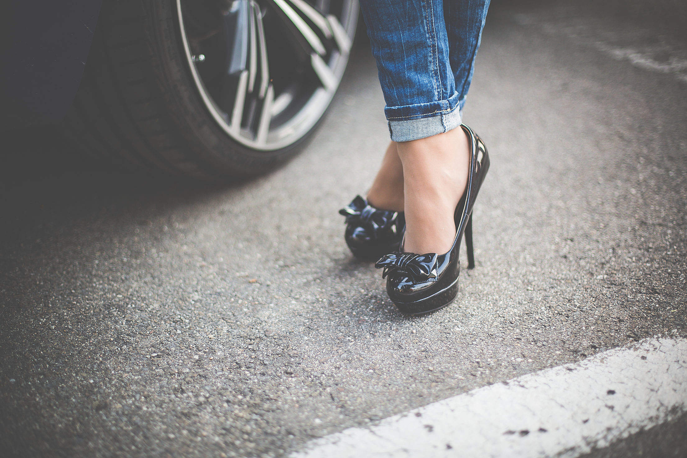 Girl in High Heels Standing in Front of Her Car Free Stock Photo