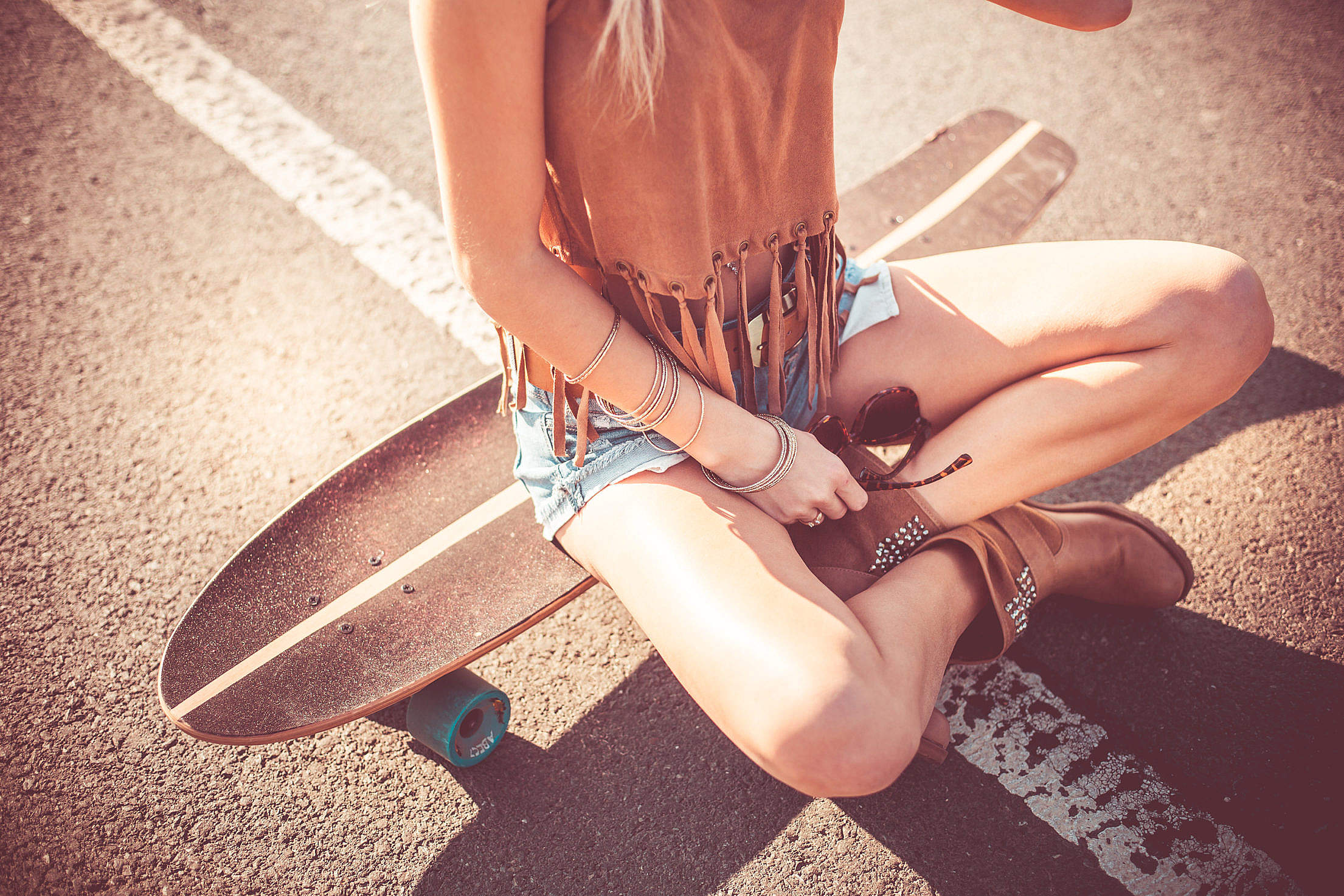 Girl Resting after Funny Ride on her Longboard Free Stock Photo