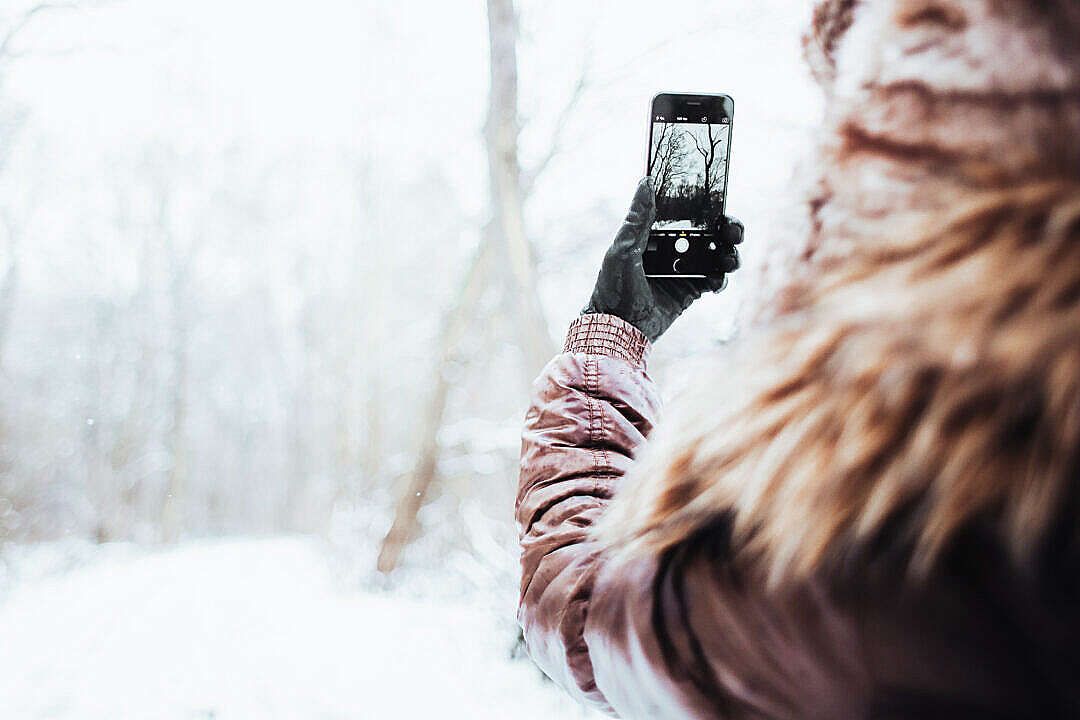 Download Girl Shooting with her iPhone 6 in Winter FREE Stock Photo