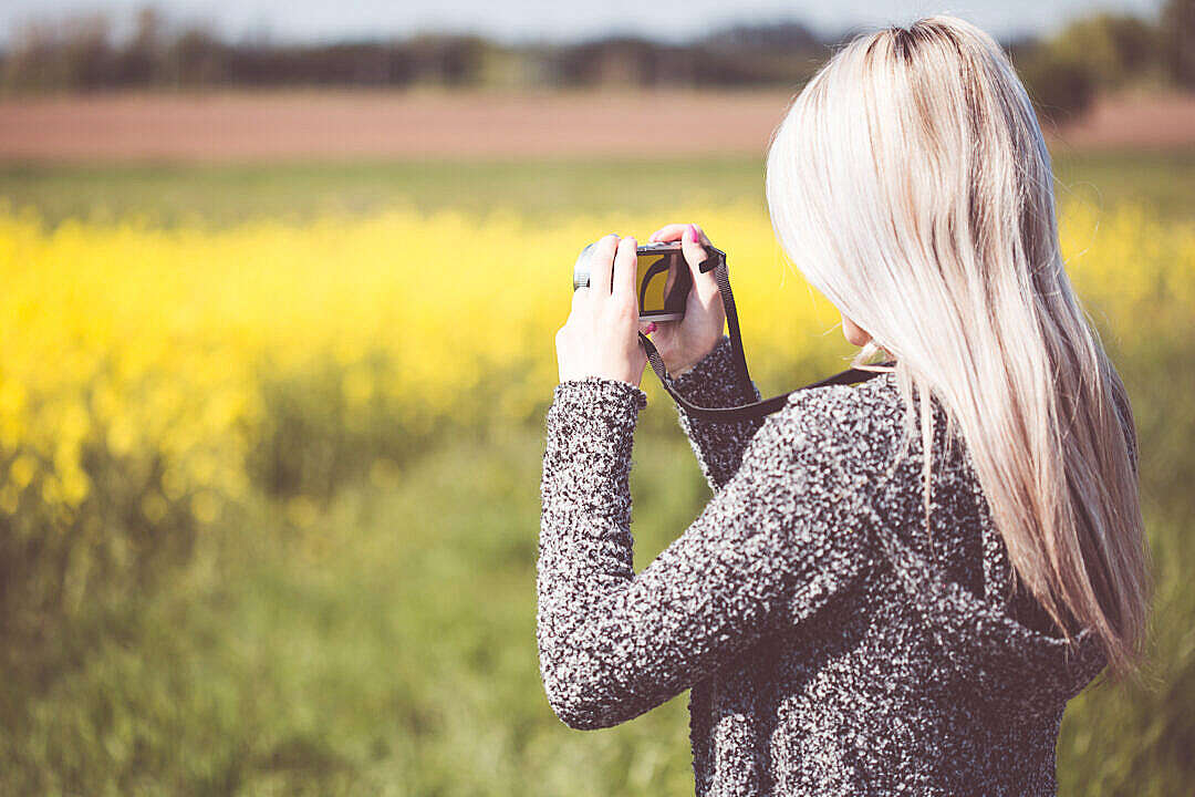Download Girl Taking a Photo in Nature FREE Stock Photo