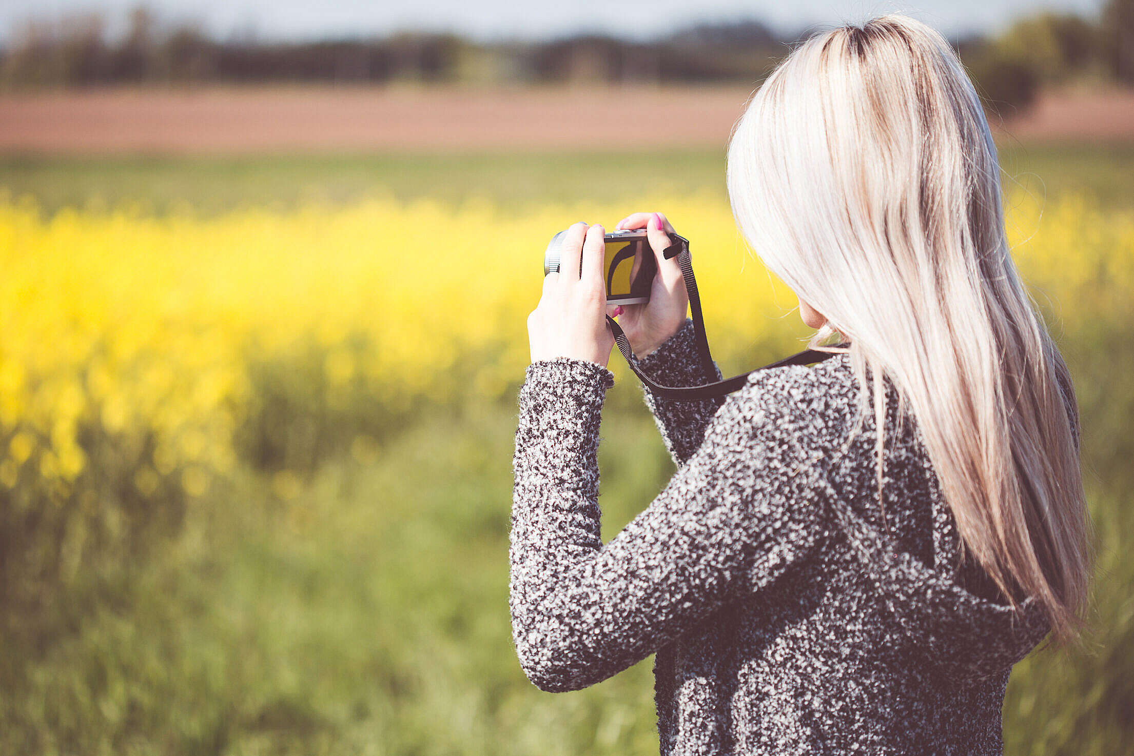 Girl Taking a Photo in Nature Free Stock Photo