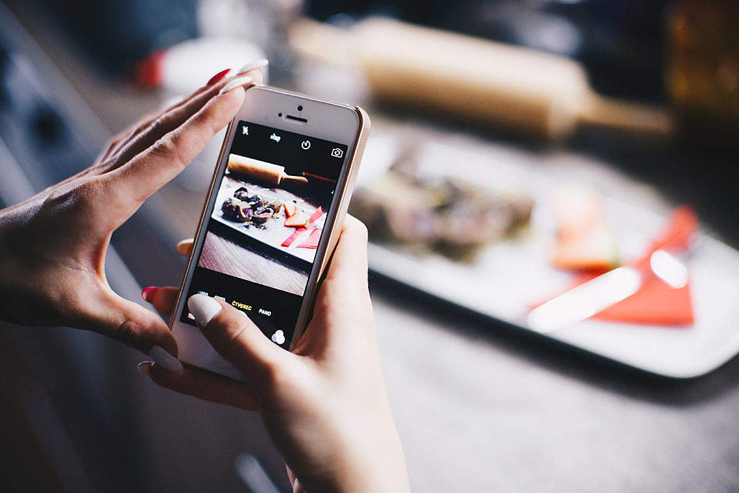 Download Girl Taking a Photo of Her Food with iPhone FREE Stock Photo