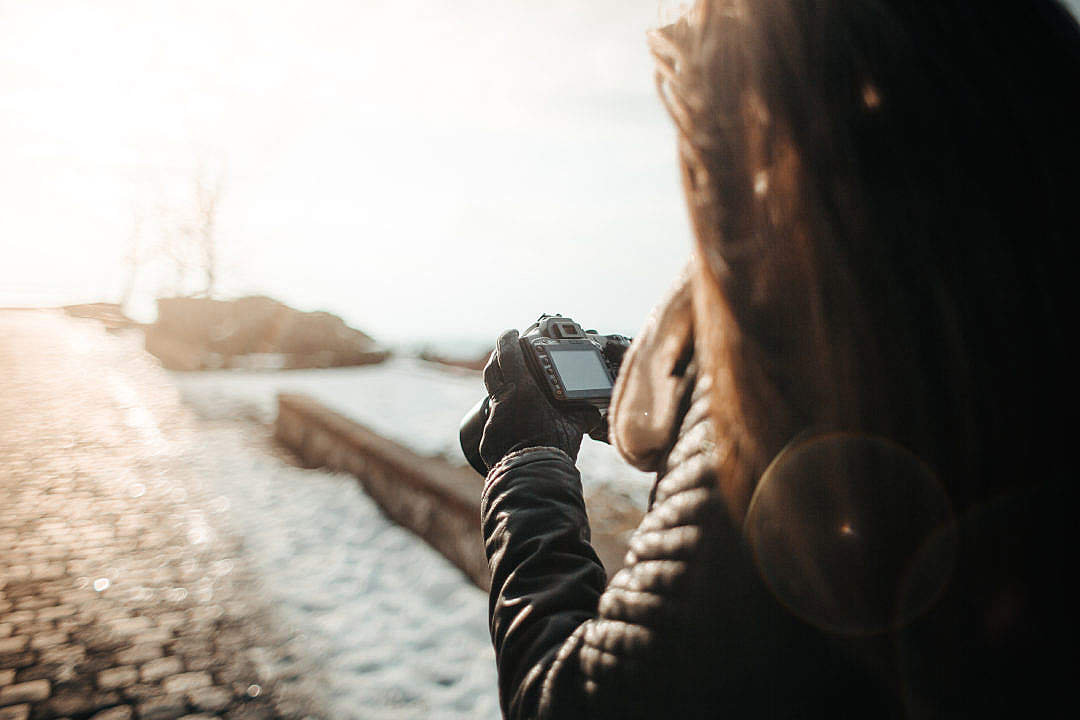 Download Girl Taking Photographs with her DSLR FREE Stock Photo