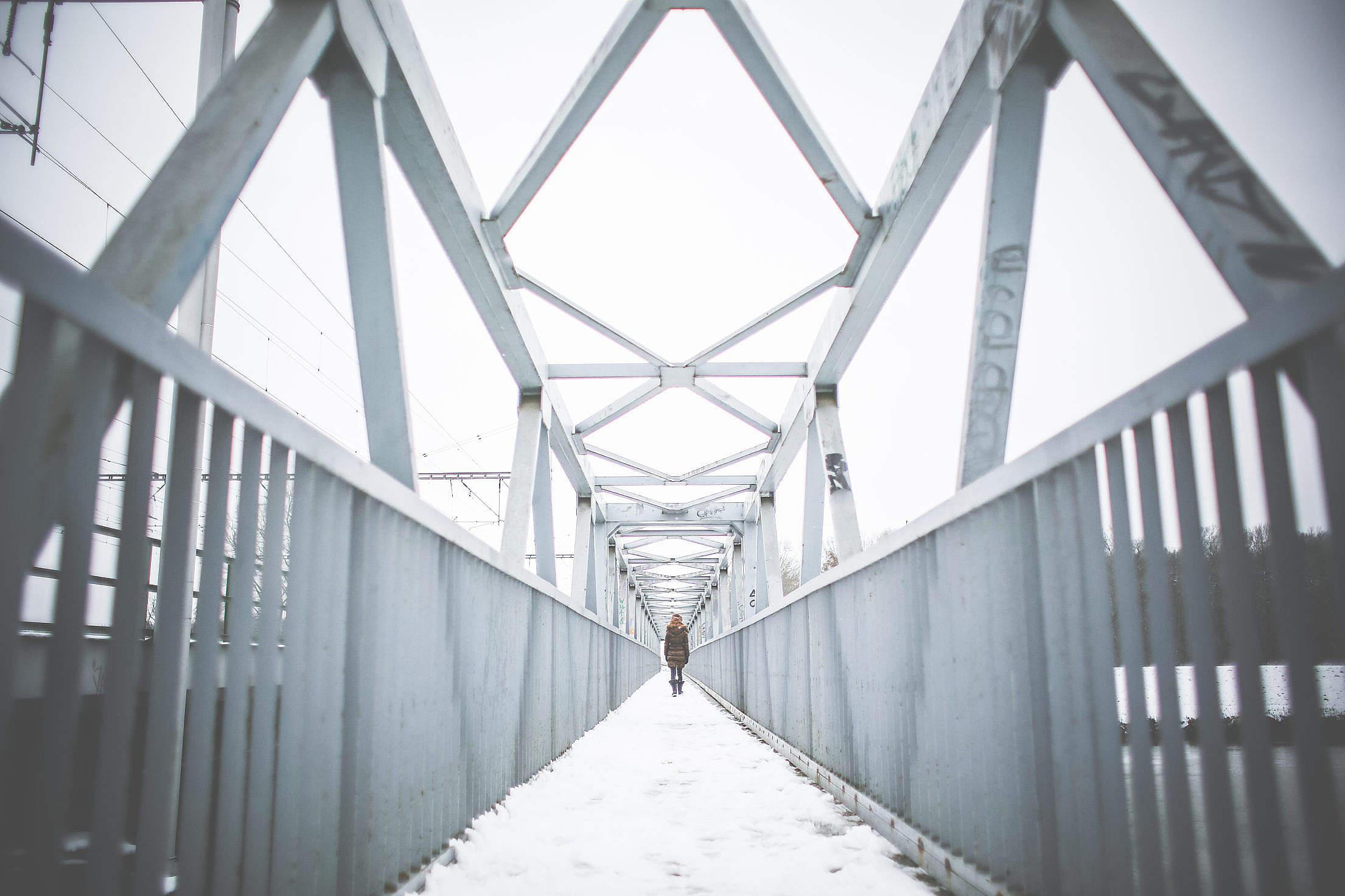 Girl Walking on Steel Bridge in Winter Free Stock Photo