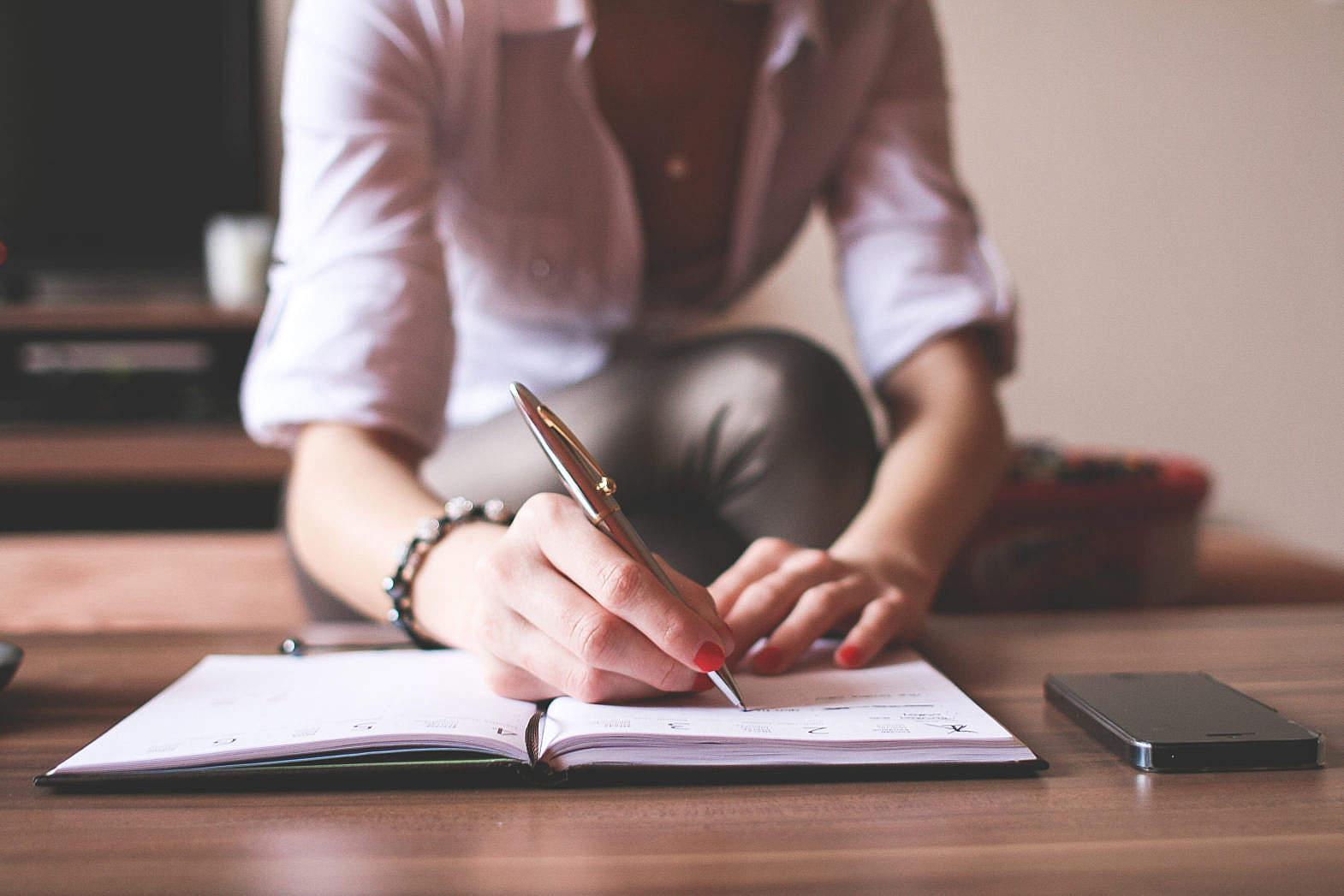Girl Writing in a Diary Free Stock Photo | picjumbo