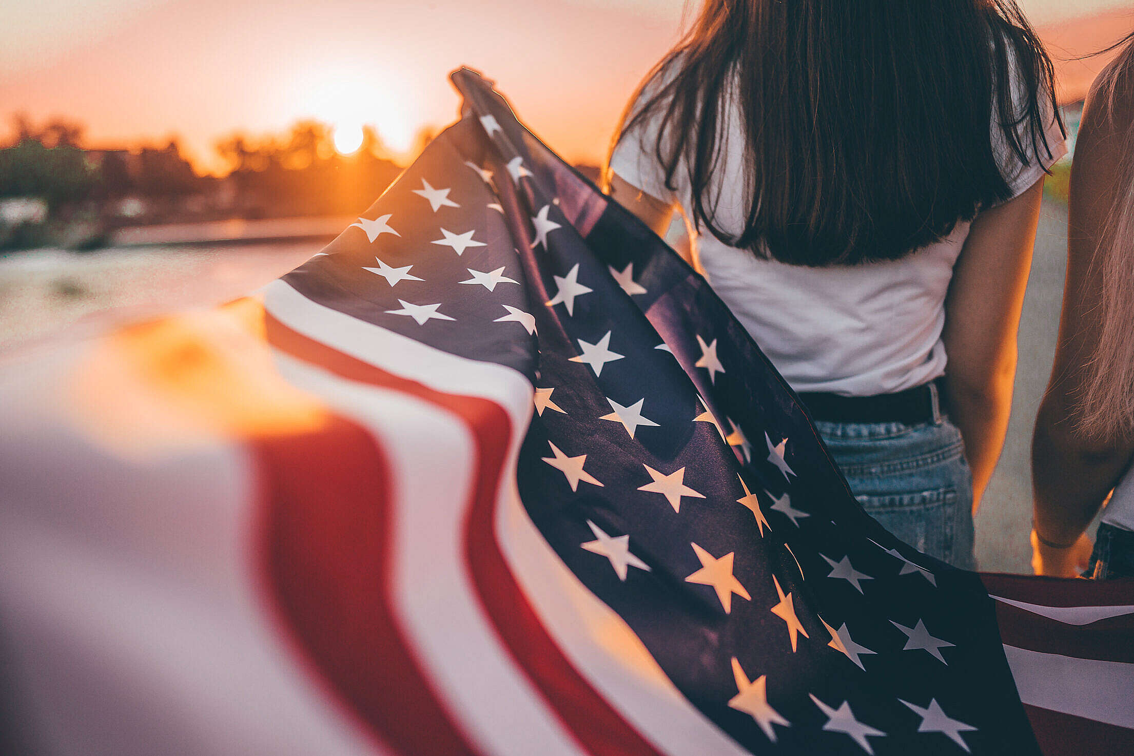 Girls Holding an American Flag Free Stock Photo