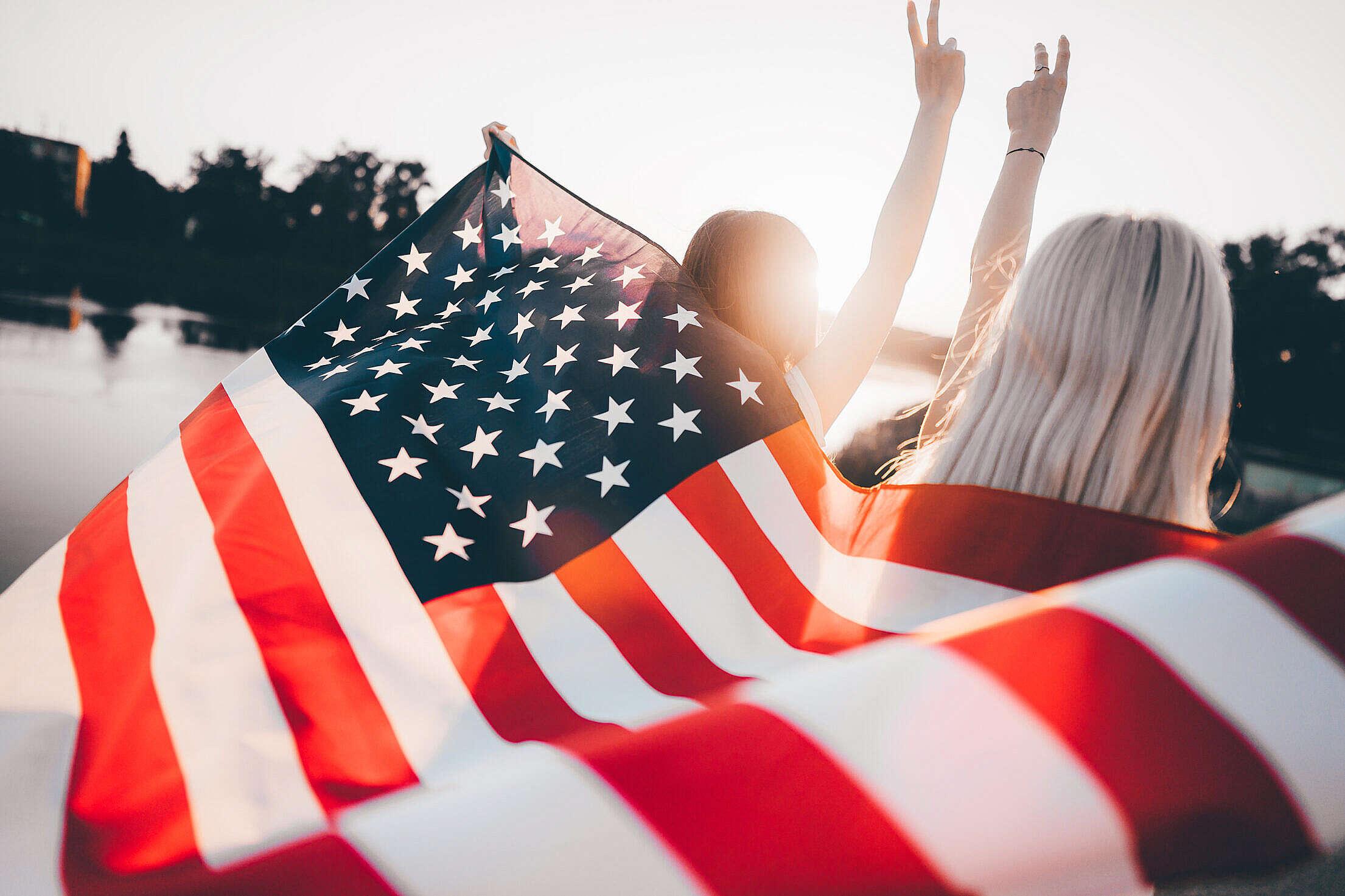 Girls Holding USA Flag Free Stock Photo