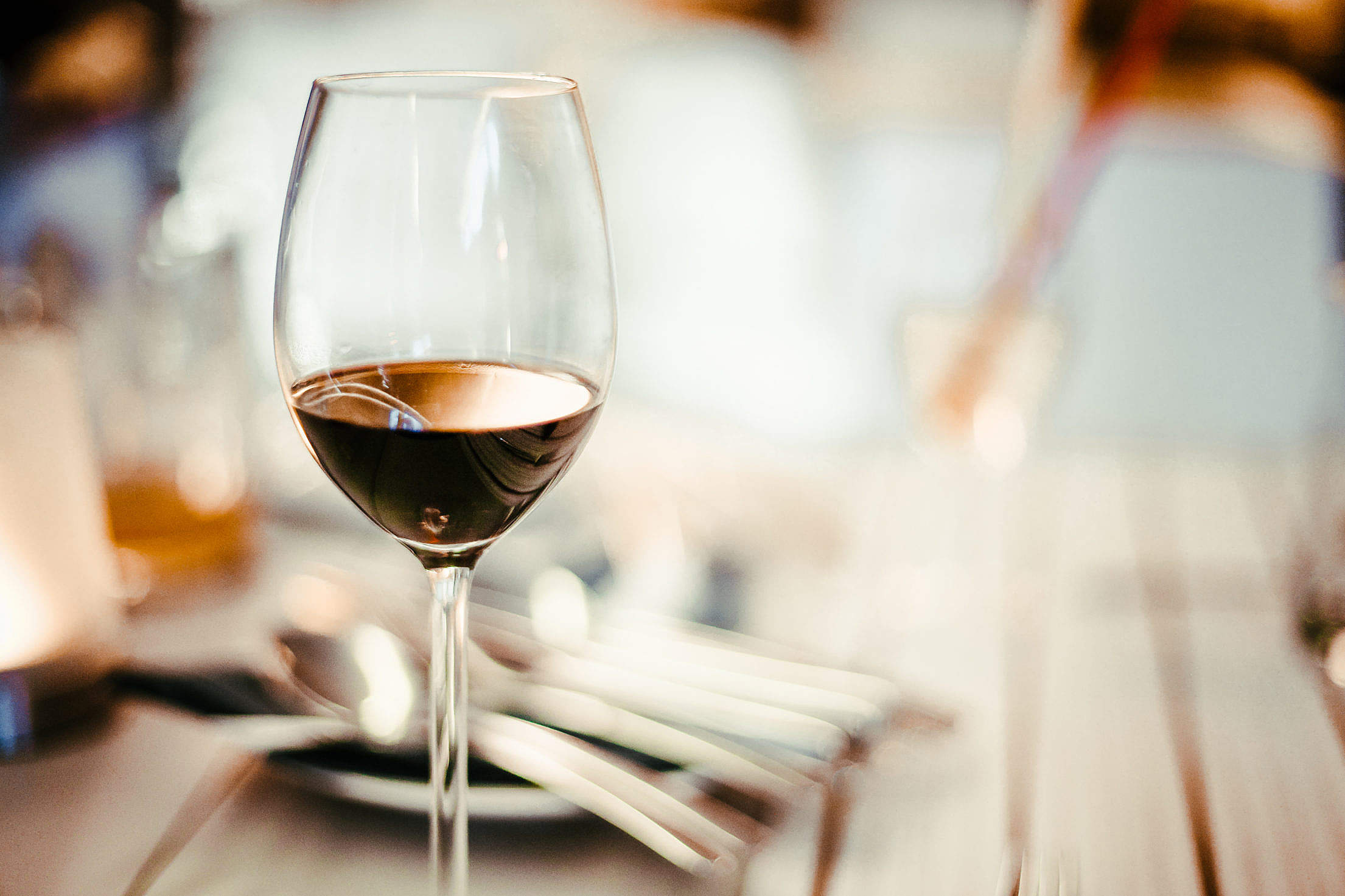 Glass of Wine on the Table Free Stock Photo