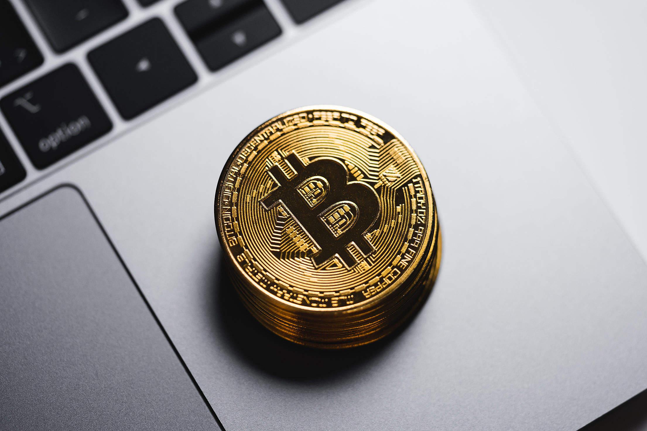 Gold Bitcoin on The MacBook Keyboard Free Stock Photo