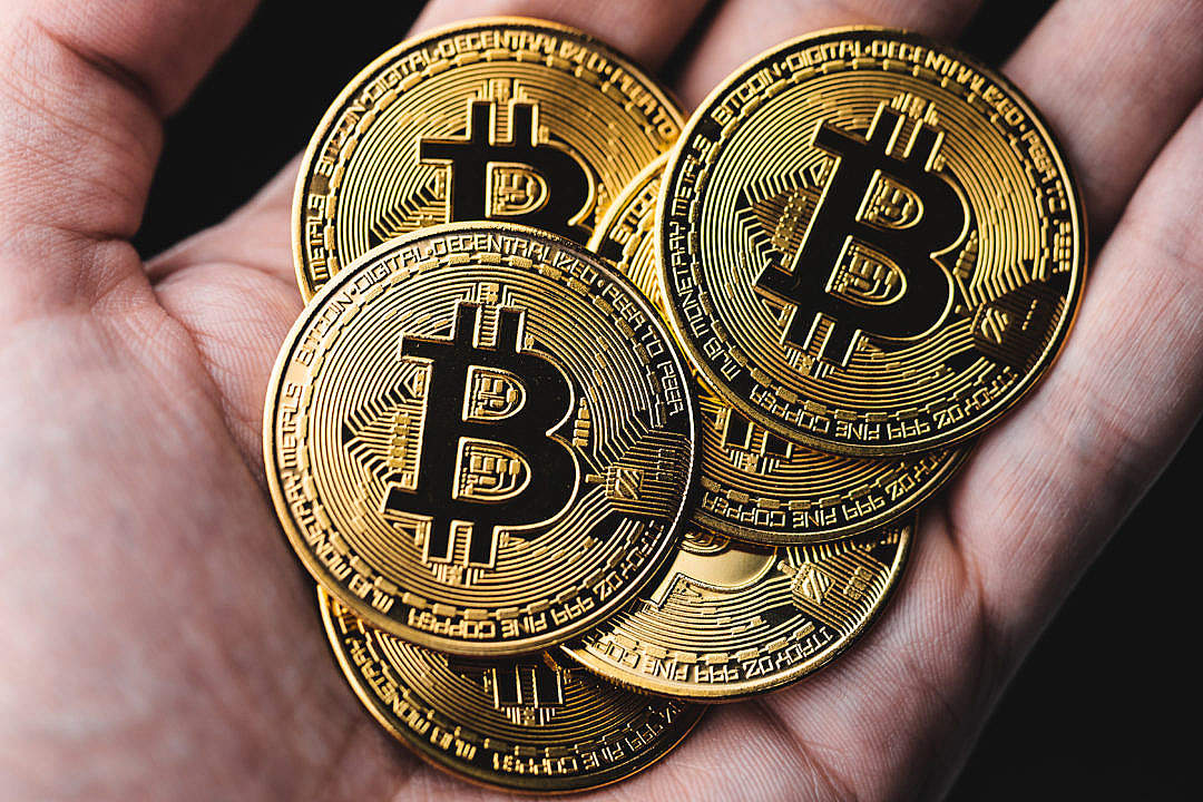 Download Gold Bitcoins in a Hand FREE Stock Photo