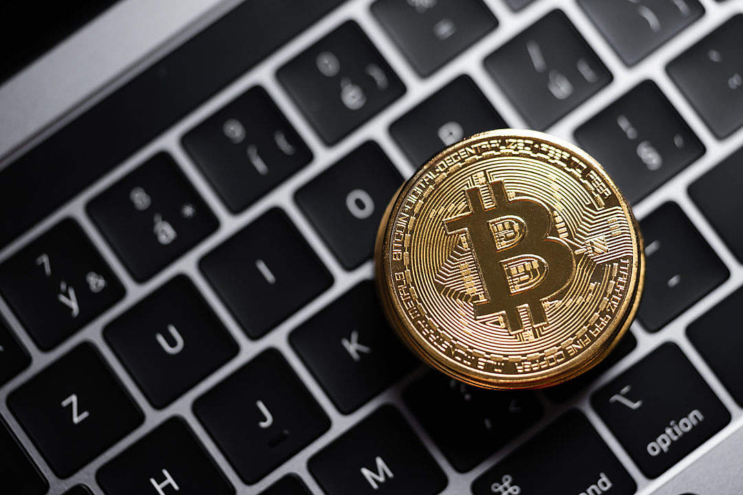 Download Golden Bitcoin on a MacBook Keyboard FREE Stock Photo