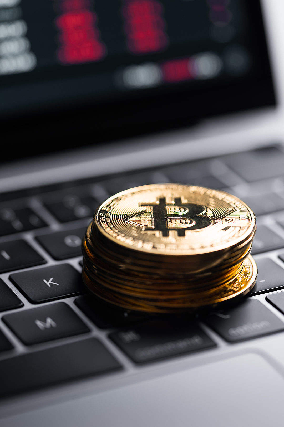 Download Golden Bitcoins on Laptop FREE Stock Photo