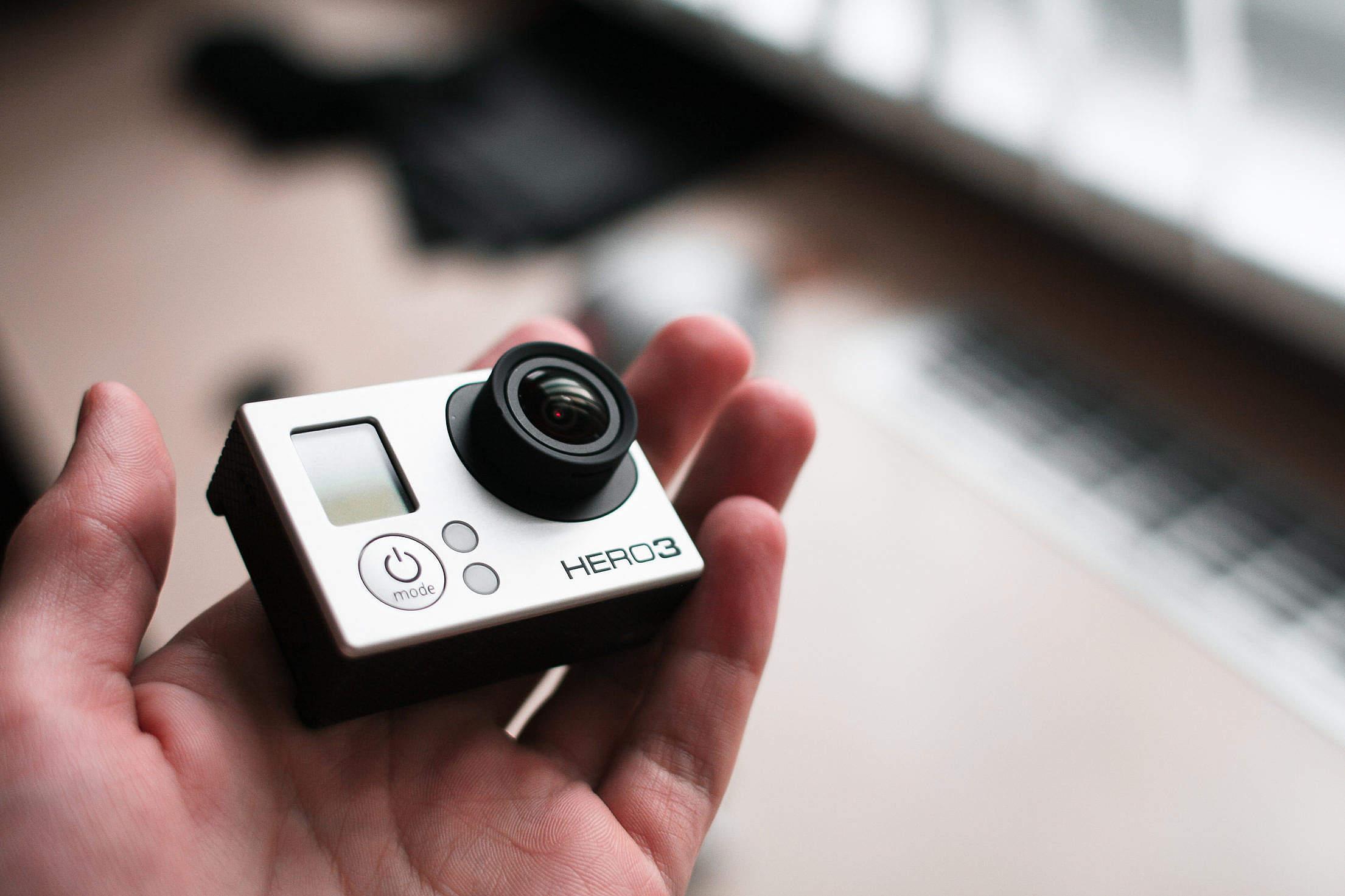 GoPro Hero 3 in Hand Free Stock Photo