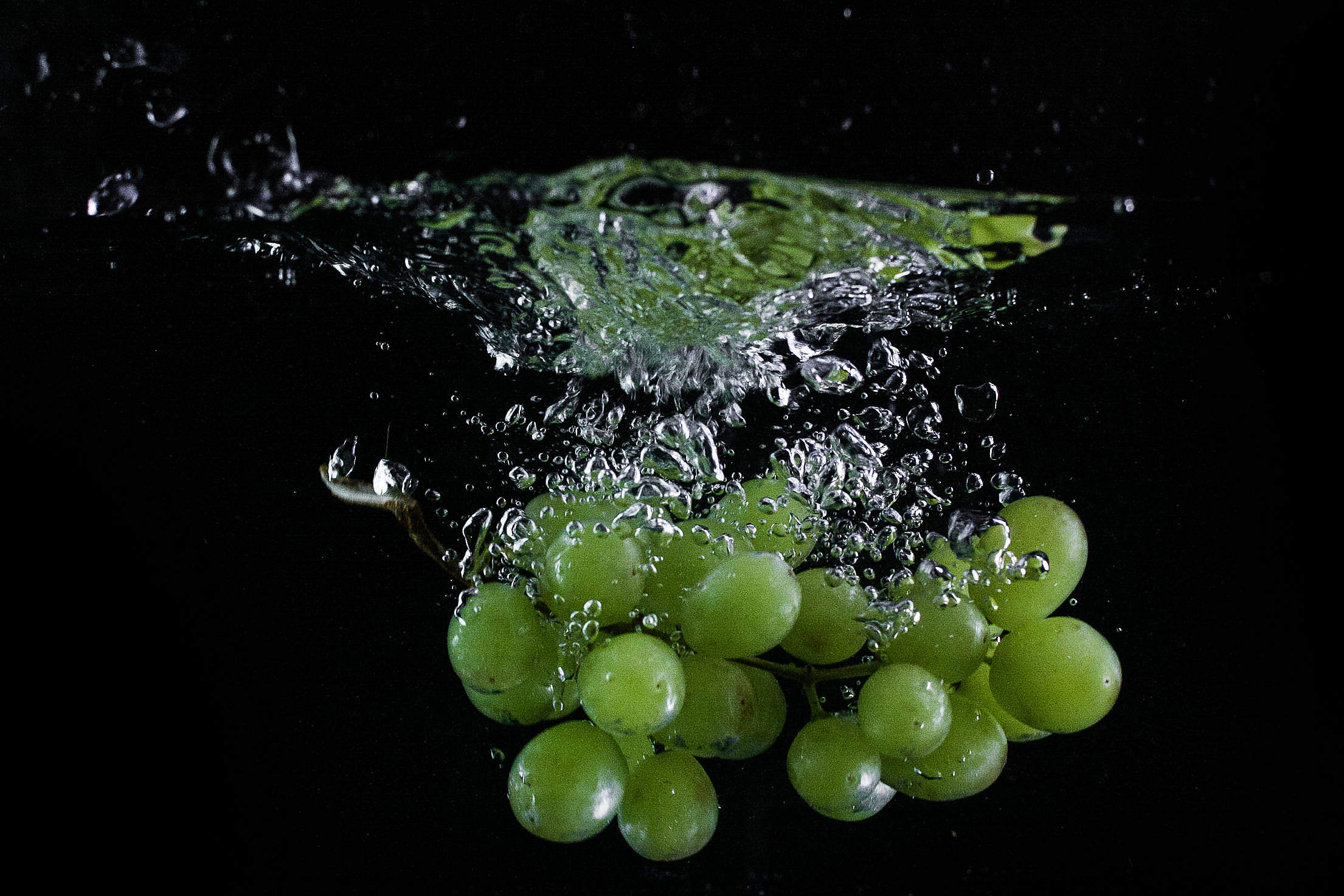 Grapes Thrown in Water Free Stock Photo