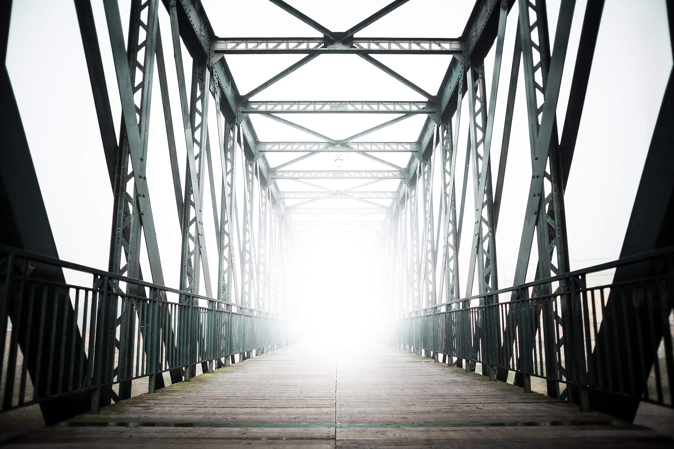 Green Old Steel Bridge in the Fog Free Stock Photo