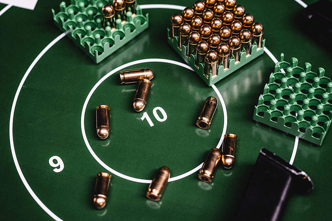 Download Green Shooting Target with a Lot of 9mm Ammunition FREE Stock Photo