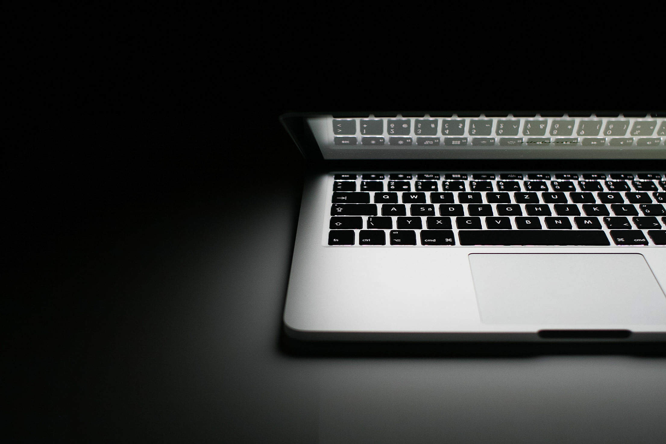 Half of MacBook Pro 2013 Free Stock Photo